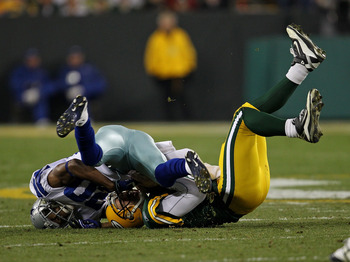 GREEN BAY, WI - NOVEMBER 07: Alan Ball #20 of the Dallas Cowboys sacks Aaron Rodgers #12 of the Green Bay Packers at Lambeau Field on November 7, 2010 in Green Bay, Wisconsin. The Packers defeated the Cowboys 45-7. (Photo by Jonathan Daniel/Getty Images)