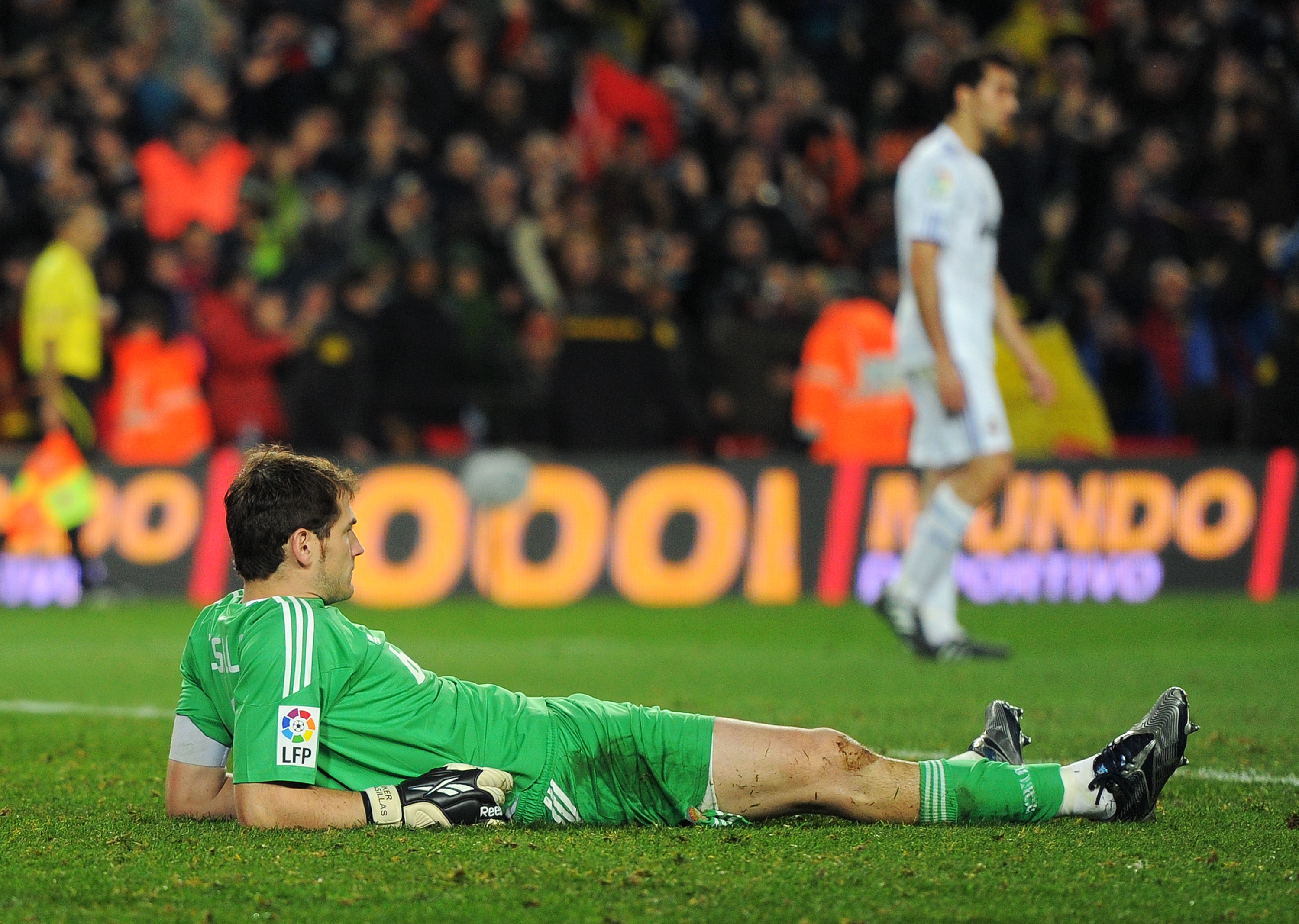 BARCELONA, SPAIN - NOVEMBER 29:  Goalkeeper Iker Casillas of Real Madrid lies dejected on the pitch after conceding his fifth goal during the la liga match between Barcelona and Real Madrid at the Camp Nou stadium on November 29, 2010 in Barcelona, Spain.