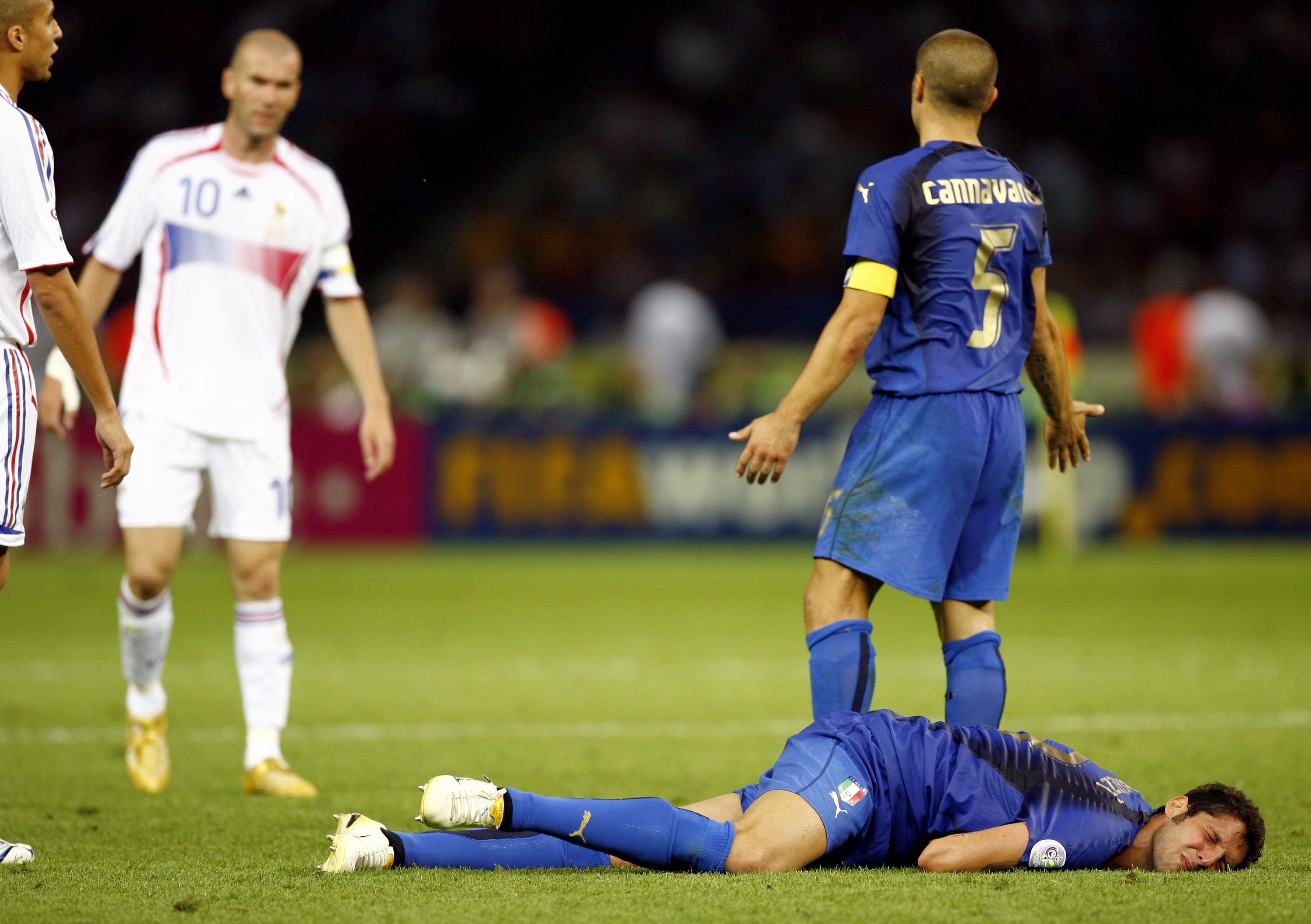 BERLIN - JULY 09:  Fabio Cannavaro (R) of Italy gestures towards Zinedine Zidane #10 (L) of France, whilst Marco Materazzi of Italy lies injured, after being headbutted  in the chest by Zinedine Zidane of France during the FIFA World Cup Germany 2006 Fina
