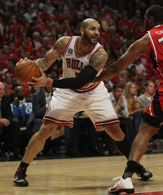 CHICAGO, IL - MAY 10: Carlos Boozer #5 of the Chicago Bulls looks to pass against the Atlanta Hawks in Game Five of the Eastern Conference Semifinals in the 2011 NBA Playoffs at the United Center on May 10, 2011 in Chicago, Illinois. The Bulls defeated th
