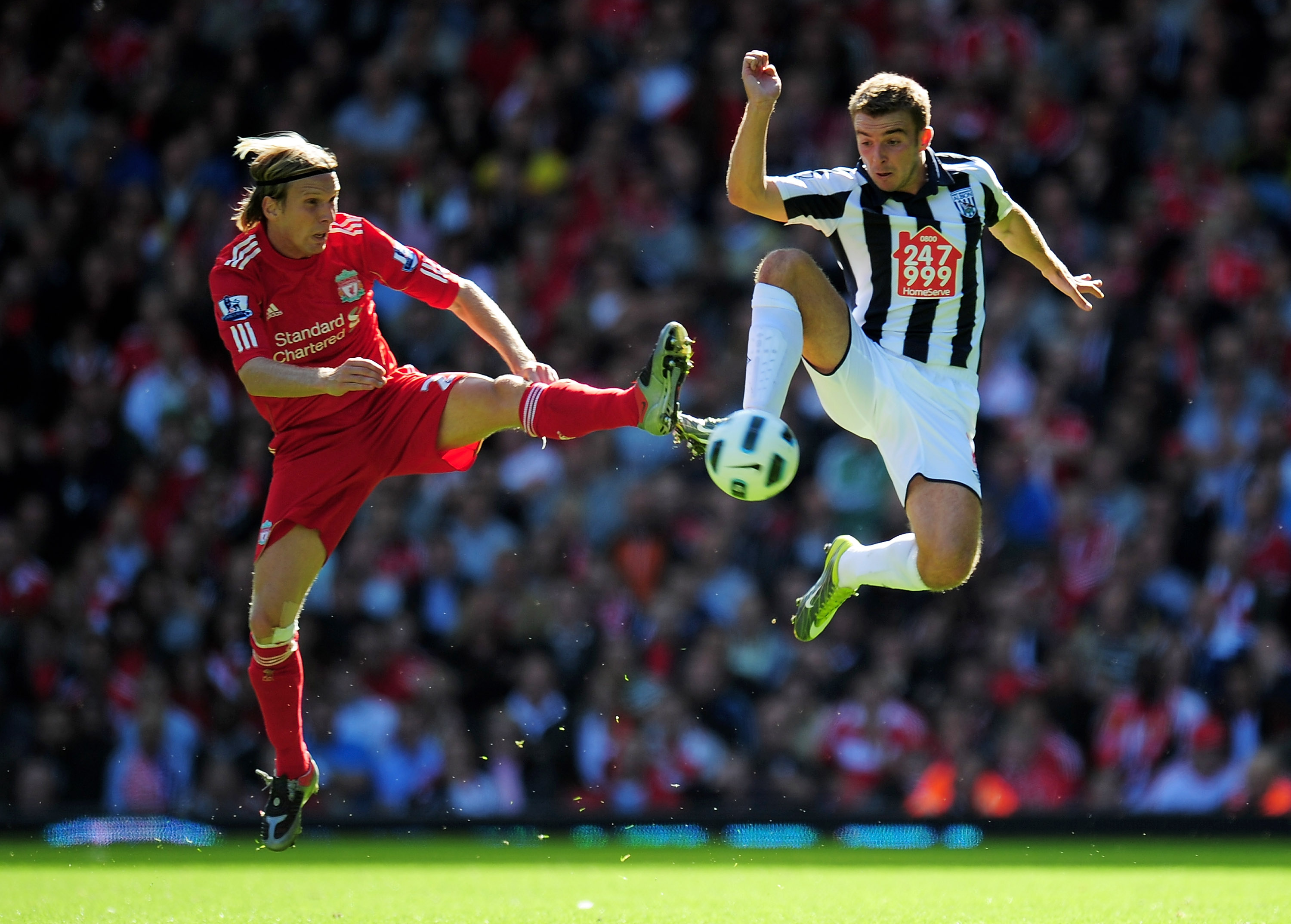 LIVERPOOL, ENGLAND - AUGUST 29:  James Morrison of West Bromwich Albion is challenged by Christian Poulsen of Liverpool during the Barclays Premier League match between Liverpool and West Bromwich Albion at Anfield on August 29, 2010 in Liverpool, England