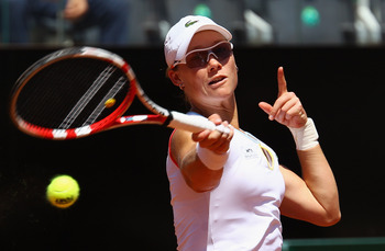 ROME, ITALY - MAY 14:  Sam Stosur of Australia plays a forehand during her semi final match against Li Na of China during day seven of the Internazoinali BNL D'Italia at the Foro Italico Tennis Centre  on May 14, 2011 in Rome, Italy.  (Photo by Clive Brun