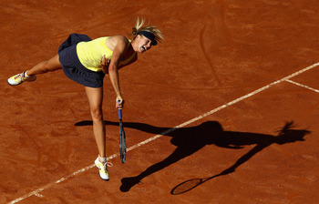ROME, ITALY - MAY 14:  Maria Sharapova of Russia serves during her semi final match against Caroline Wozniacki of Denmark during day seven of the Internazoinali BNL D'Italia at the Foro Italico Tennis Centre  on May 14, 2011 in Rome, Italy.  (Photo by Cli