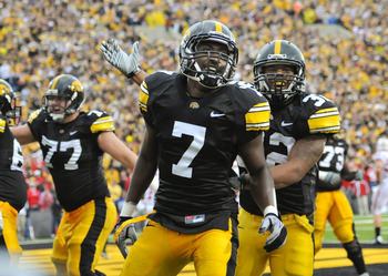IOWA CITY, IA - OCTOBER 23- Wide receiver Marvin McNutt Jr. #7 of the University of Iowa Hawkeyes celebrates with teammate running back Adam Robinson #32 after scoring a touchdown against the Wisconsin Badgers during the second half of play at Kinnick Sta