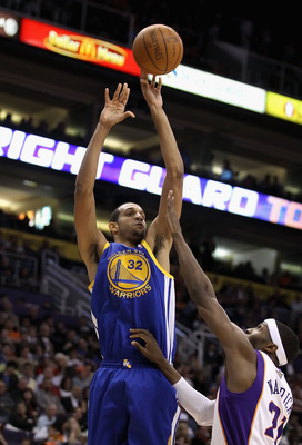 PHOENIX, AZ - FEBRUARY 10:  Brandan Wright #32 of the Golden State Warriors puts up a shot over Hakim Warrick #21 of the Phoenix Suns during the NBA game at US Airways Center on February 10, 2011 in Phoenix, Arizona. The Suns defeated the Warriors 112-88.
