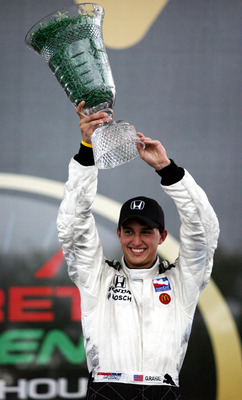 ST.PETERSBURG, FL - APRIL 06: Graham Rahal in the #06 Hole in the Wall Camps Newman/Haas/Lanigan Racing car holds up the winning trophy after the IRL IndyCar Series Honda Grand Prix of St. Petersburg on April 6, 2008 on the streets of St. Petersburg, Flor