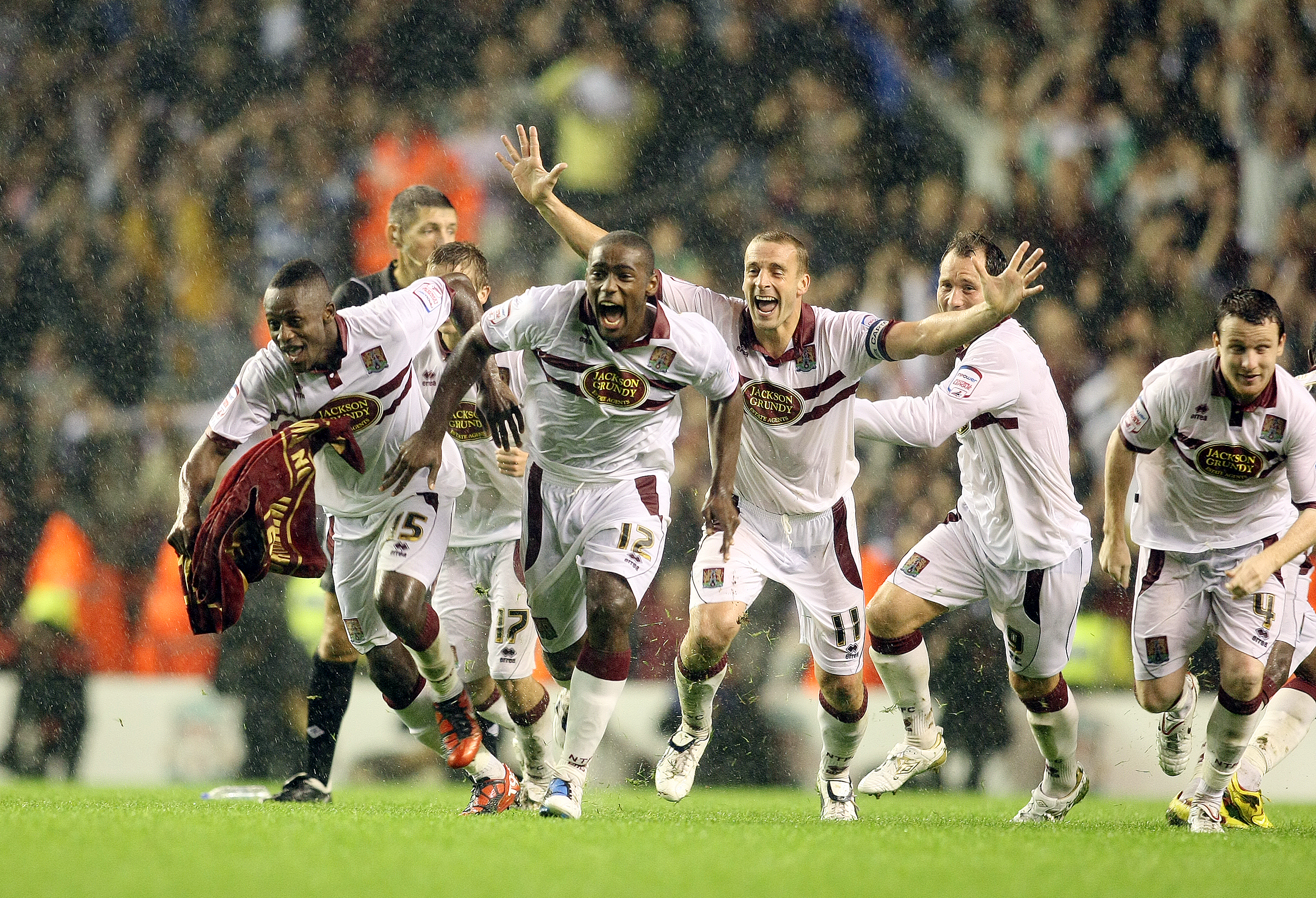 LIVERPOOL, ENGLAND - SEPTEMBER 22:  Northampton Town players celebrate victory after Abdul Osman had scored the winning penalty in the penalty shoot out during the Carling Cup Third Round match between Liverpool and Northampton Town at Anfield on Septembe