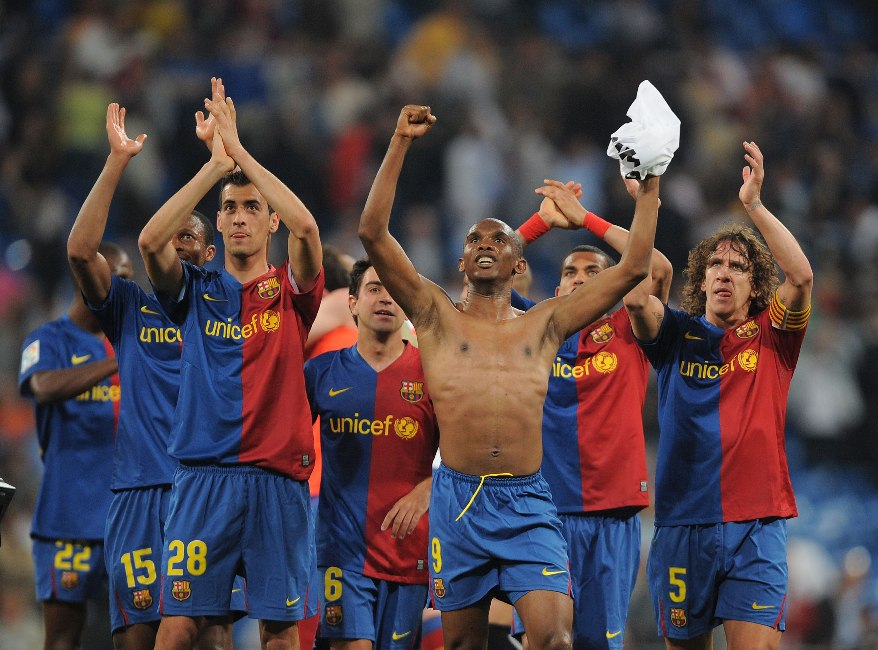 MADRID, SPAIN - MAY 02:  Samuel Eto'o (#9) Sergio Busquets (#28) and Carles Puyol (#5) of Barcelona celebrate after Barcelona beat Real 6-1 during the La Liga match between Real Madrid and Barcelona at the Santiago Bernabeu stadium on May 2, 2009 in Madri