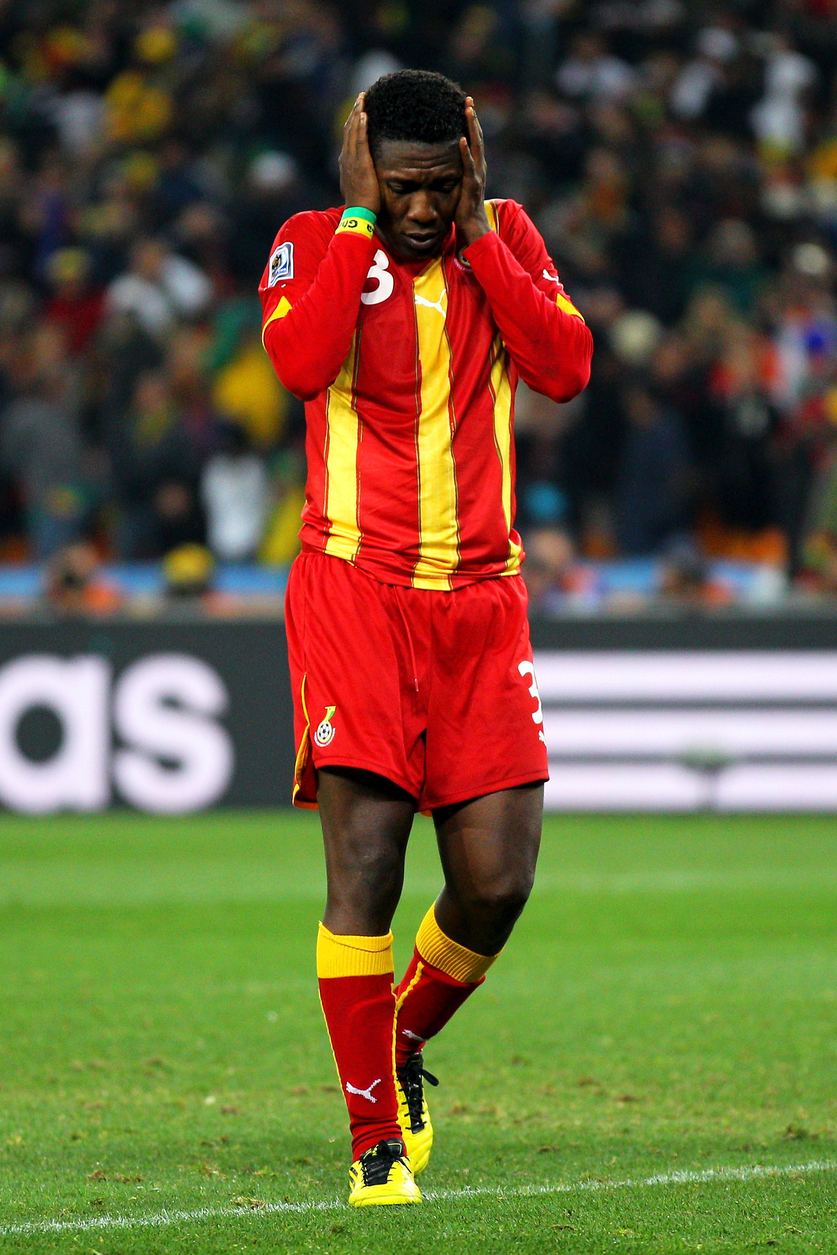JOHANNESBURG, SOUTH AFRICA - JULY 02:  Asamoah Gyan of Ghana looks dejected after missing his penalty during the 2010 FIFA World Cup South Africa Quarter Final match between Uruguay and Ghana at the Soccer City stadium on July 2, 2010 in Johannesburg, Sou