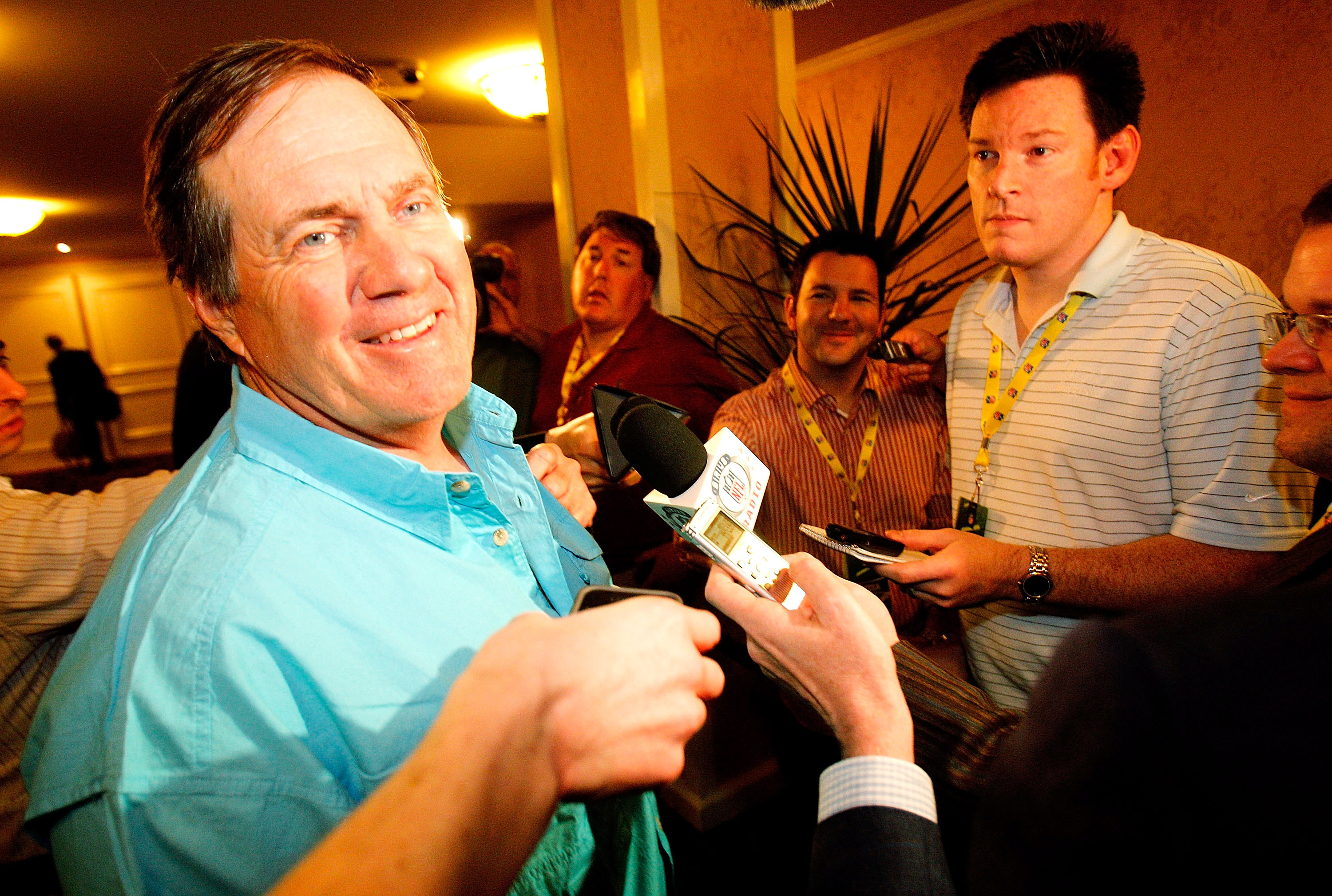 NEW ORLEANS, LA - MARCH 21: New England Patriot head coach Bill Belichick jokes with the media after missing breakfast during the NFL Annual Meetings at the Roosevelt Hotel on March 21, 2011 in New Orleans, Louisiana. Despite a NFL owners imposed lockout