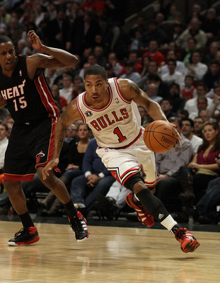 CHICAGO, IL - FEBRUARY 24: Derrick Rose #1 of the Chicago Bulls drives past Mario Chalmers #15 of the Miami Heat at the United Center on February 24, 2011 in Chicago, Illinois. The Bulls defeated the Heat 93-89. NOTE TO USER: User expressly acknowledges a