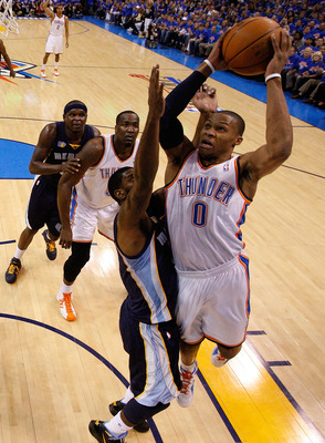 OKLAHOMA CITY, OK - MAY 15:  Guard Russell Westbrook #0 of the Oklahoma City Thunder takes a shot against O.J. Mayo #33 of the Memphis Grizzlies in Game Seven of the Western Conference Semifinals in the 2011 NBA Playoffs on May 15, 2011 at Oklahoma City A