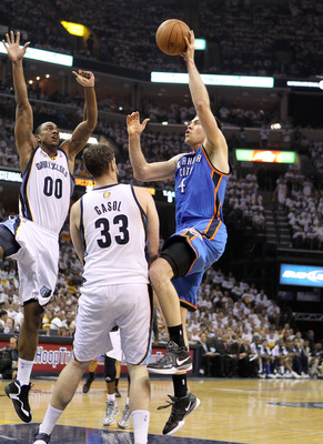MEMPHIS, TN - MAY 09:  Nick Collison #4 of the Oklahoma City Thunder shoots the ball while defended by Marc Gasol #33 of the Memphis Grizzlies in Game Four of the Western Conference Semifinals in the 2011 NBA Playoffs at FedExForum on May 9, 2011 in Memph