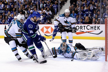 VANCOUVER, CANADA - MAY 15:  Goaltender Antti Niemi #31 of the San Jose Sharks makes a save on shot by Jannik Hansen #36 of the Vancouver Canucks in the second period in Game One of the Western Conference Finals during the 2011 Stanley Cup Playoffs at Rog