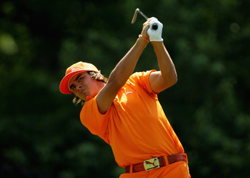 CHARLOTTE, NC - MAY 08:  Rickie Fowler hits a shot during the final round of the Wells Fargo Championship at the Quail Hollow Club on May 8, 2011 in Charlotte, North Carolina.  (Photo by Scott Halleran/Getty Images)