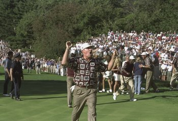 26 Sep 1999:  Justin Leonard of the USA asks the USA team to leave the 17th green during the 33rd Ryder Cup match played at the Brookline CC in Boston, Massachusetts, USA. \ Mandatory Credit: Andrew Redington /Allsport