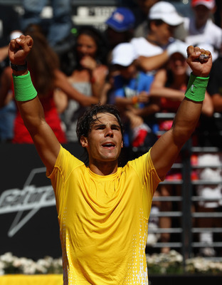 ROME, ITALY - MAY 14:  Rafael Nadal of Spain  celebrates victory after his semi final match against Richard Gasquet of France during day seven of the Internazoinali BNL D'Italia at the Foro Italico Tennis Centre  on May 14, 2011 in Rome, Italy.  (Photo by
