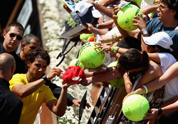 ROME, ITALY - MAY 11:  Rafael Nadal of Spain signs autographs after his second round match against Paolo Lorenzi of Italy during day four of the Internazoinali BNL D'Italia at the Foro Italico Tennis Centre on May 11, 2011 in Rome, Italy.  (Photo by Clive
