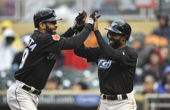 MINNEAPOLIS, MN - MAY 14: Jose Bautista #19 and Corey Patterson #16 of the Toronto Blue Jays celebrate a two-run home run by Bautista against the Minnesota Twins during the eleventh inning on May 14, 2011 at Target Field in Minneapolis, Minnesota. Blue Ja