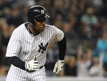 NEW YORK, NY - MAY 15:  Curtis Granderson #14 of the New York Yankees hits a two run home run in the second inning against the Boston Red Sox  during their game on May 15, 2011 at Yankee Stadium in the Bronx borough of New York City.  (Photo by Al Bello/G