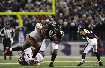 BALTIMORE, MD - NOVEMBER 28:  Anquan Boldin #81 of the Baltimore Ravens runs the ball against the Tampa Bay Buccaneers at M&T Bank Stadium on November 28, 2010 in Baltimore, Maryland. The Ravens defeated the Buccaneers 17-10. (Photo by Larry French/Getty
