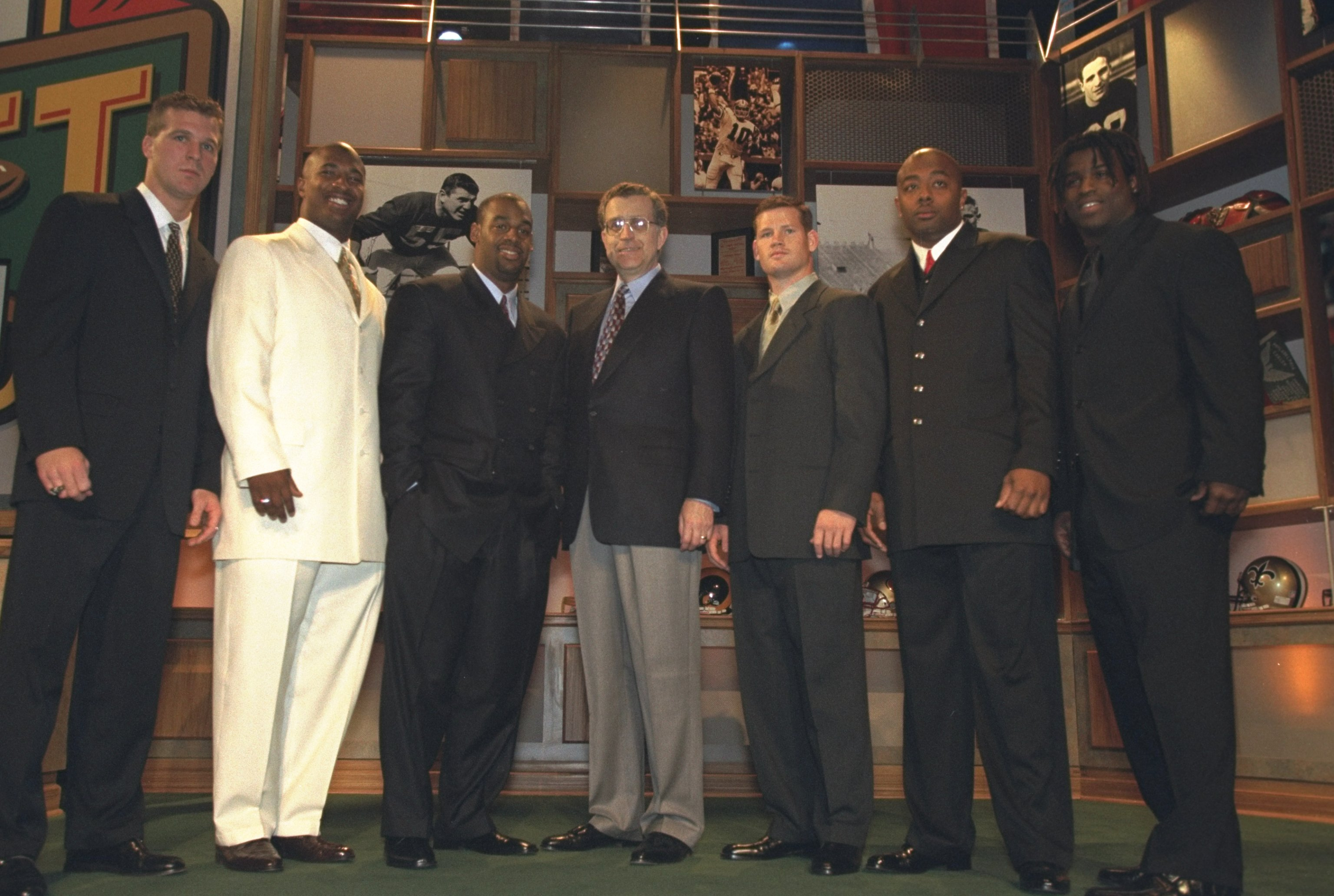 17 Apr 1999: From (L) to (R); Tim Couch, Daunte Culpepper, Donovan McNabb, Paul Tagliabue, Cade McNown, Akili Smith and Ricky Williams pose for the camera during the NFL Draft at the Madison Square Garden in New York, New York.