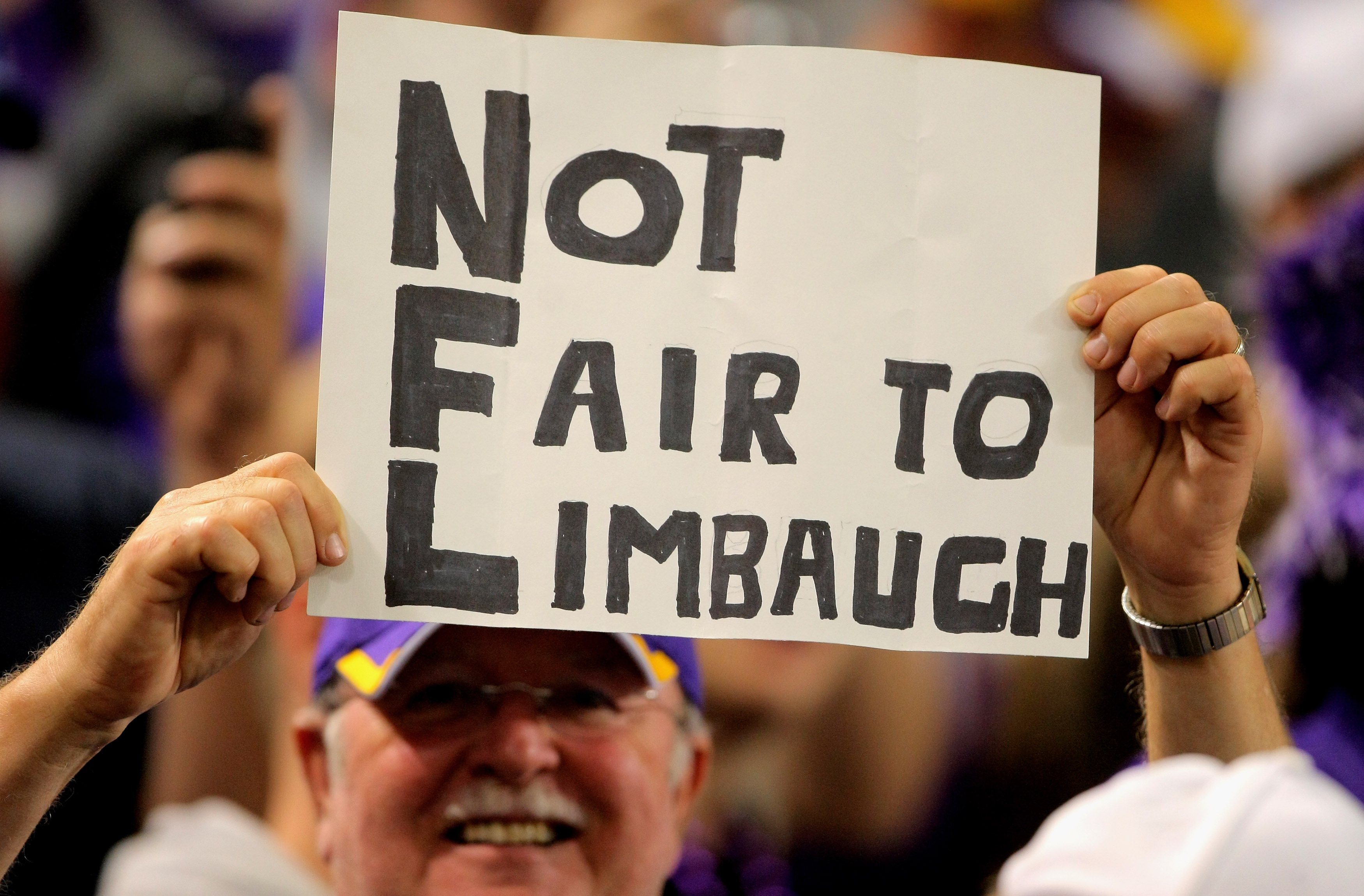 MINNEAPOLIS - OCTOBER 18:  A fan holds a sign in support of Rush Limbaugh as the Minnesota Vikings host the Baltimore Ravens during NFL action at Hubert H. Humphrey Metrodome on October 18, 2009 in Minneapolis, Minnesota. Te Vikings defeated the Ravens 33