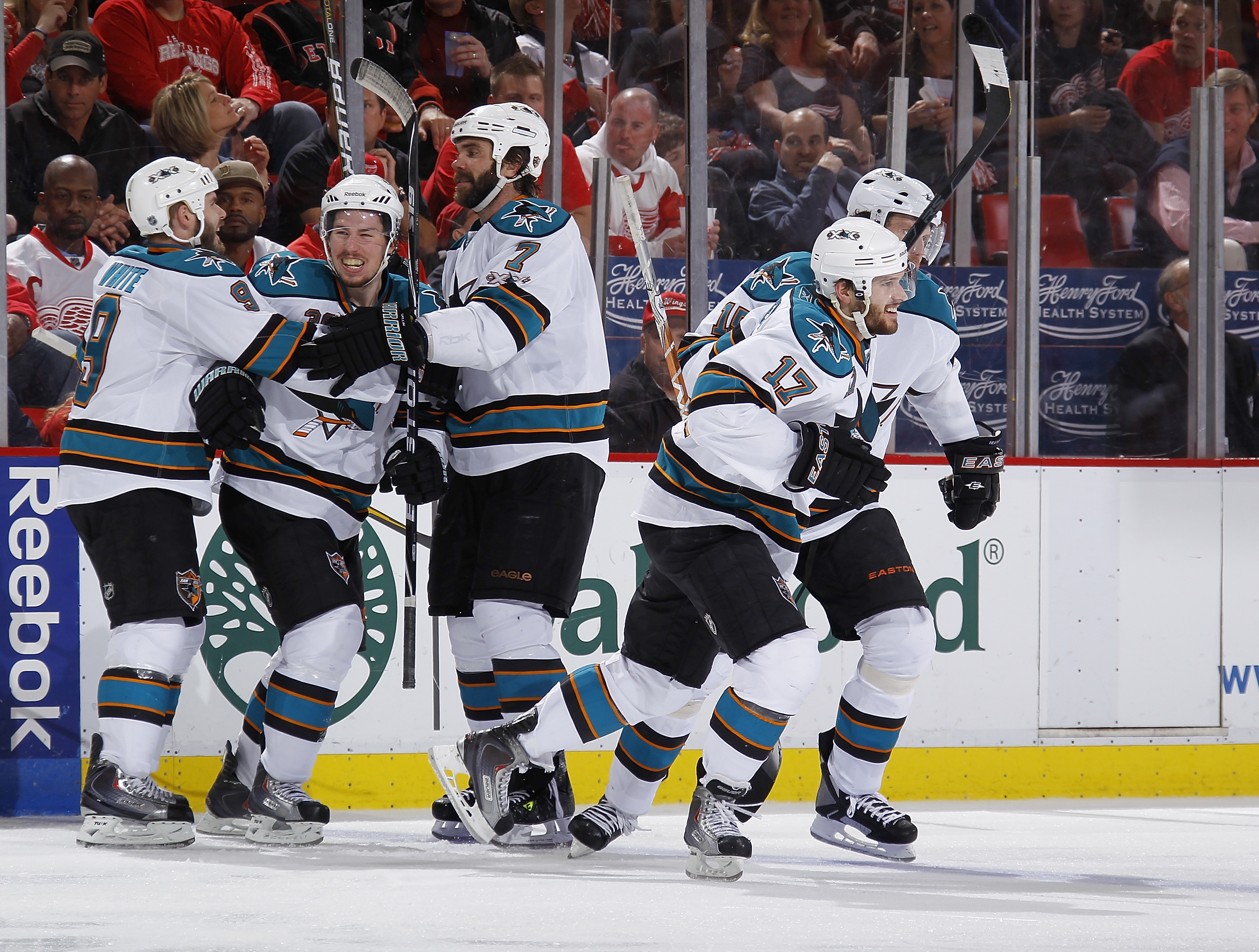 DETROIT - MAY 10: Logan Couture #39 of the San Jose Sharks scores a third period goal and celebrates with teammates Torrey Mitchell #17, Niclas Wallin #7, Ian White #9, and Dany Heatley #15 while playing against the Detroit Red Wings in Game Six of the We