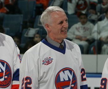 UNIONDALE, NY - MARCH 02:  (L-R) Clark Gillies, Mike Bossy and Bryan Trottier of 'The 'Core of the Four' New York Islanders Stanley Cup championships take part in a ceremony prior to the Islanders game against the Florida Panthers on March 2, 2008 at the
