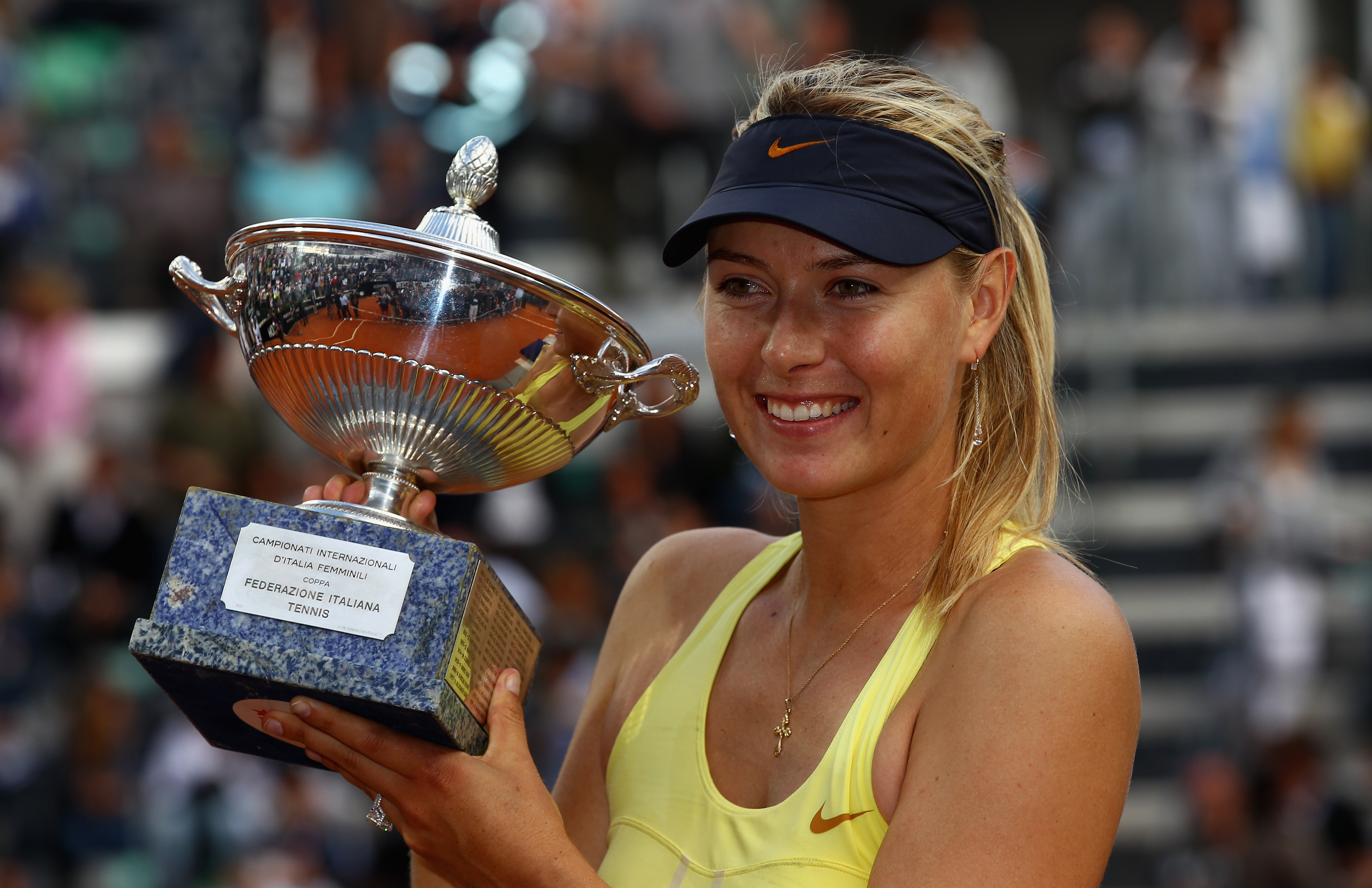 ROME, ITALY - MAY 15:  Maria Sharapova of Russia poses with the trophy after her victory in the final against Samantha Stosur of Australia during day eight of the Internazoinali BNL D'Italia at the Foro Italico Tennis Centre on May 15, 2011 in Rome, Italy