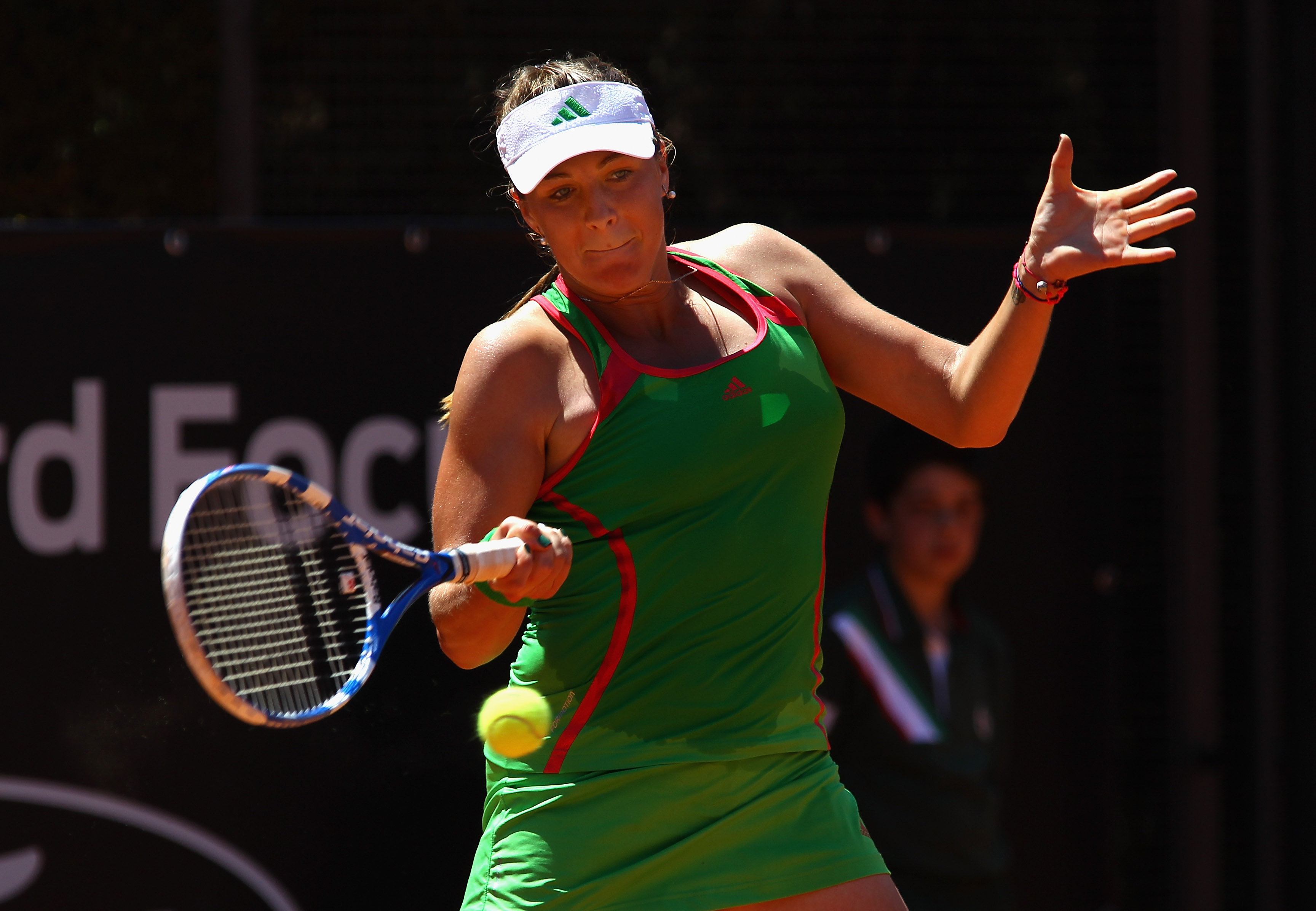 ROME, ITALY - MAY 11:  Anastasia Pavlyuchenkova of Russia plays a forehand return during her second round match against Vera Dushevina of Russia during day four of the Internazionali BNL d'Italia at the Foro Italico Tennis Centreon May 11, 2011 in Rome, I
