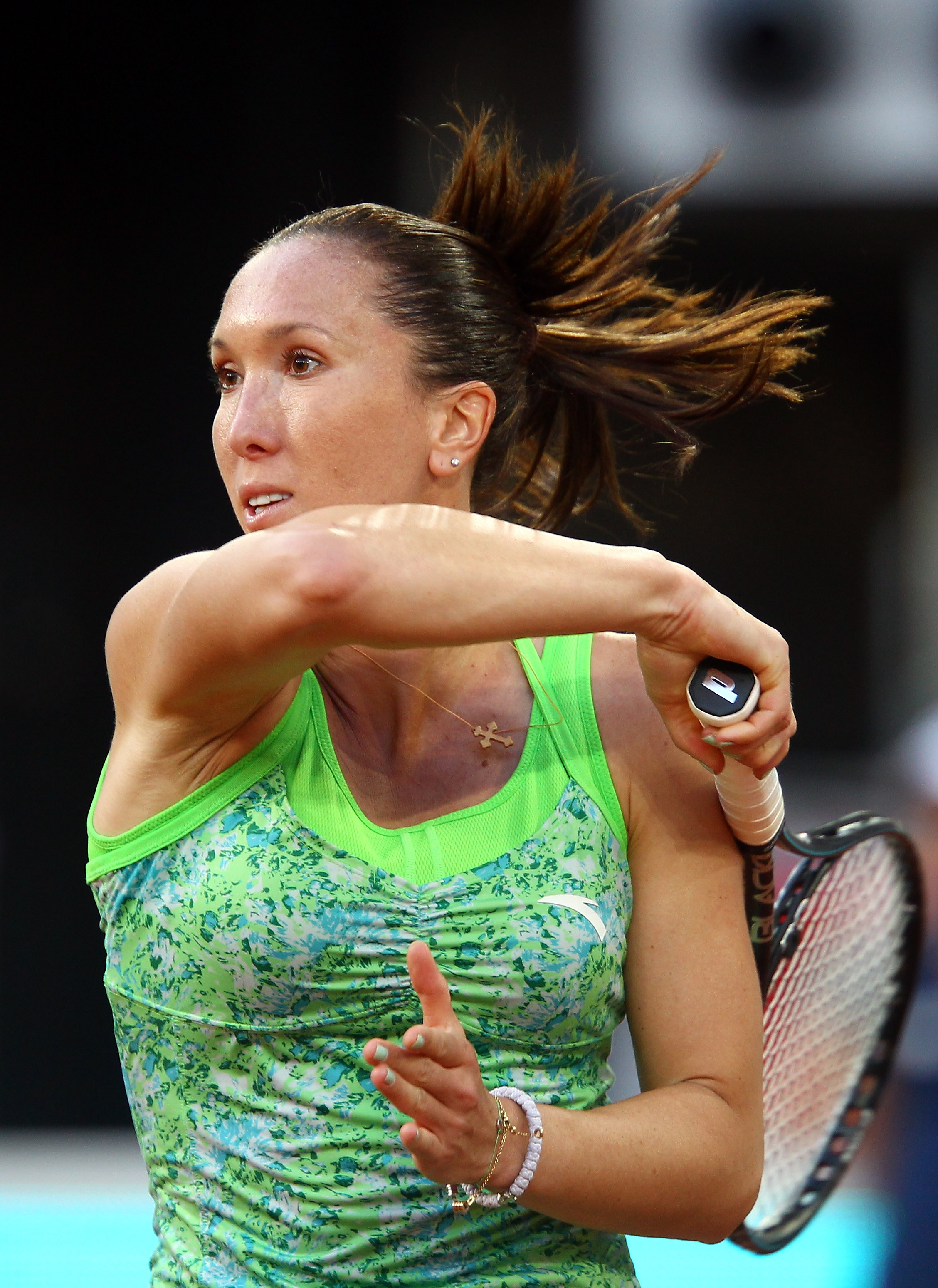 MADRID, SPAIN - MAY 01:  Jelena Jankovic of Serbia in action against Laura Pous-Tio of Spain during day two of the Mutua Madrilena Madrid Open Tennis on May 1, 2011 in Madrid, Spain.  (Photo by Julian Finney/Getty Images)