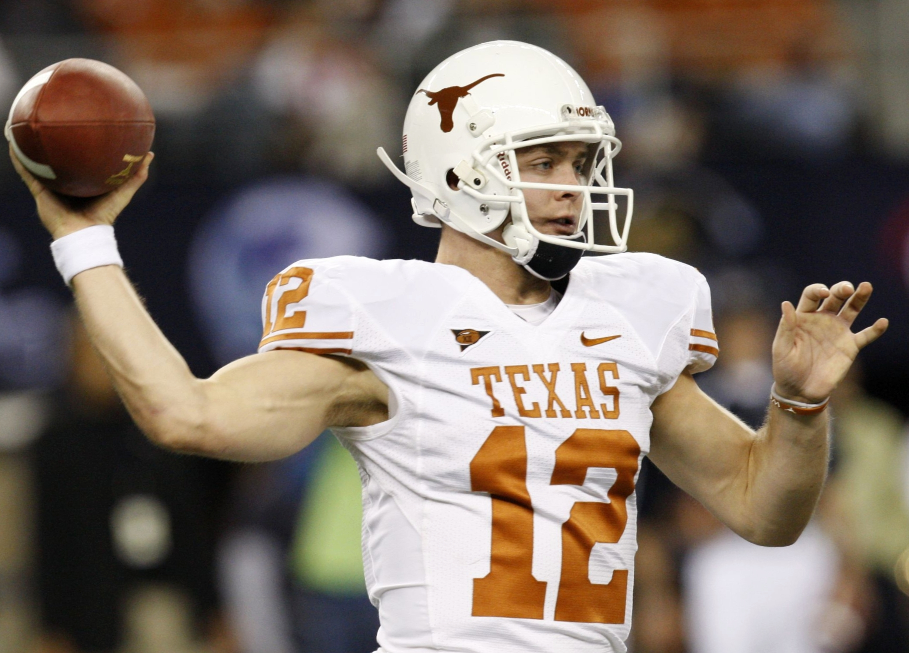 ARLINGTON, TX - DECEMBER 5:  Quarterback Colt McCoy #12 of the Texas Longhorns passes the ball against the Nebraska Cornhuskers at Cowboys Stadium on December 5, 2009 in Arlington, Texas.  (Photo by Ronald Martinez/Getty Images)
