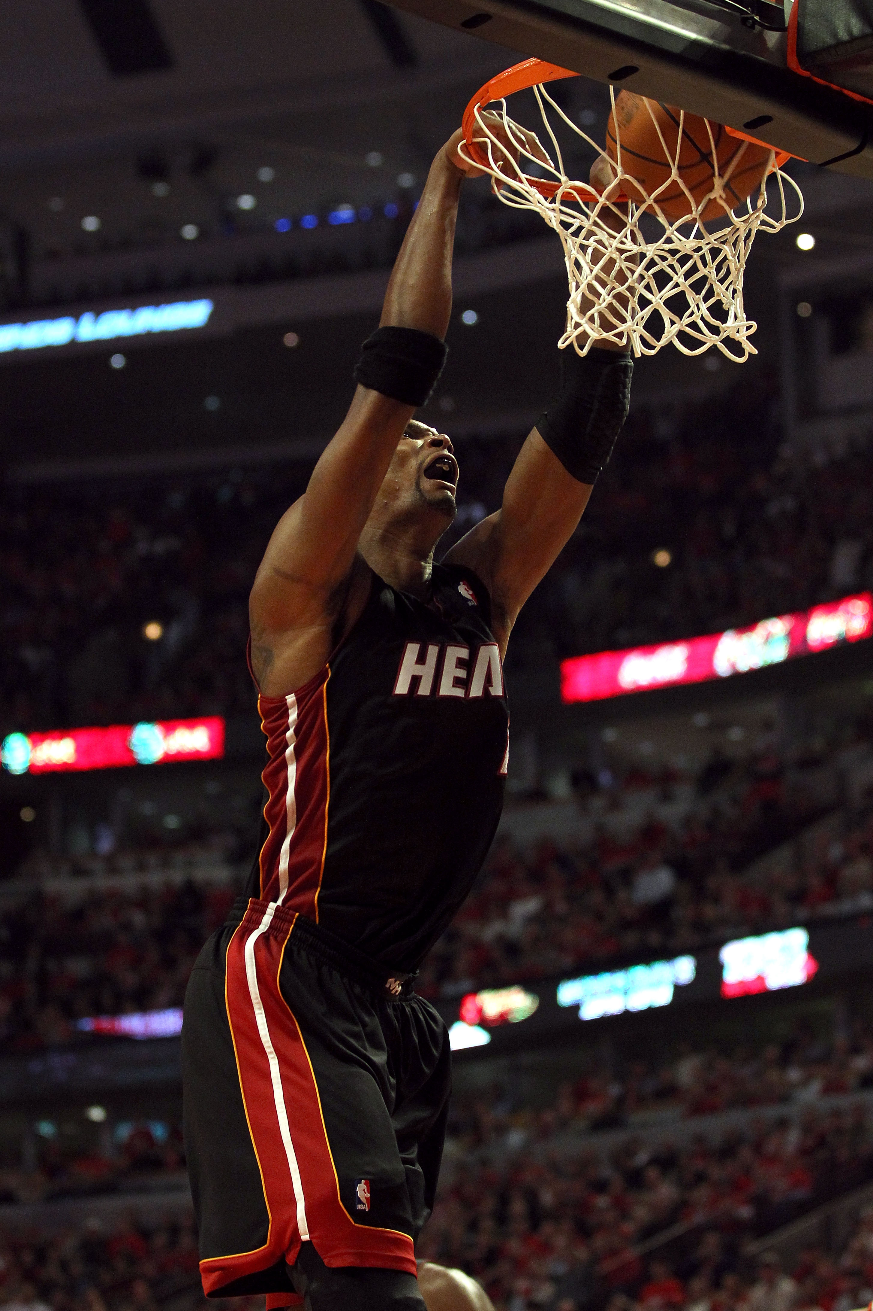CHICAGO, IL - MAY 15: Chris Bosh #1 of the Miami Heat dunks against the Chicago Bulls in Game One of the Eastern Conference Finals during the 2011 NBA Playoffs on May 15, 2011 at the United Center in Chicago, Illinois. NOTE TO USER: User expressly acknowl