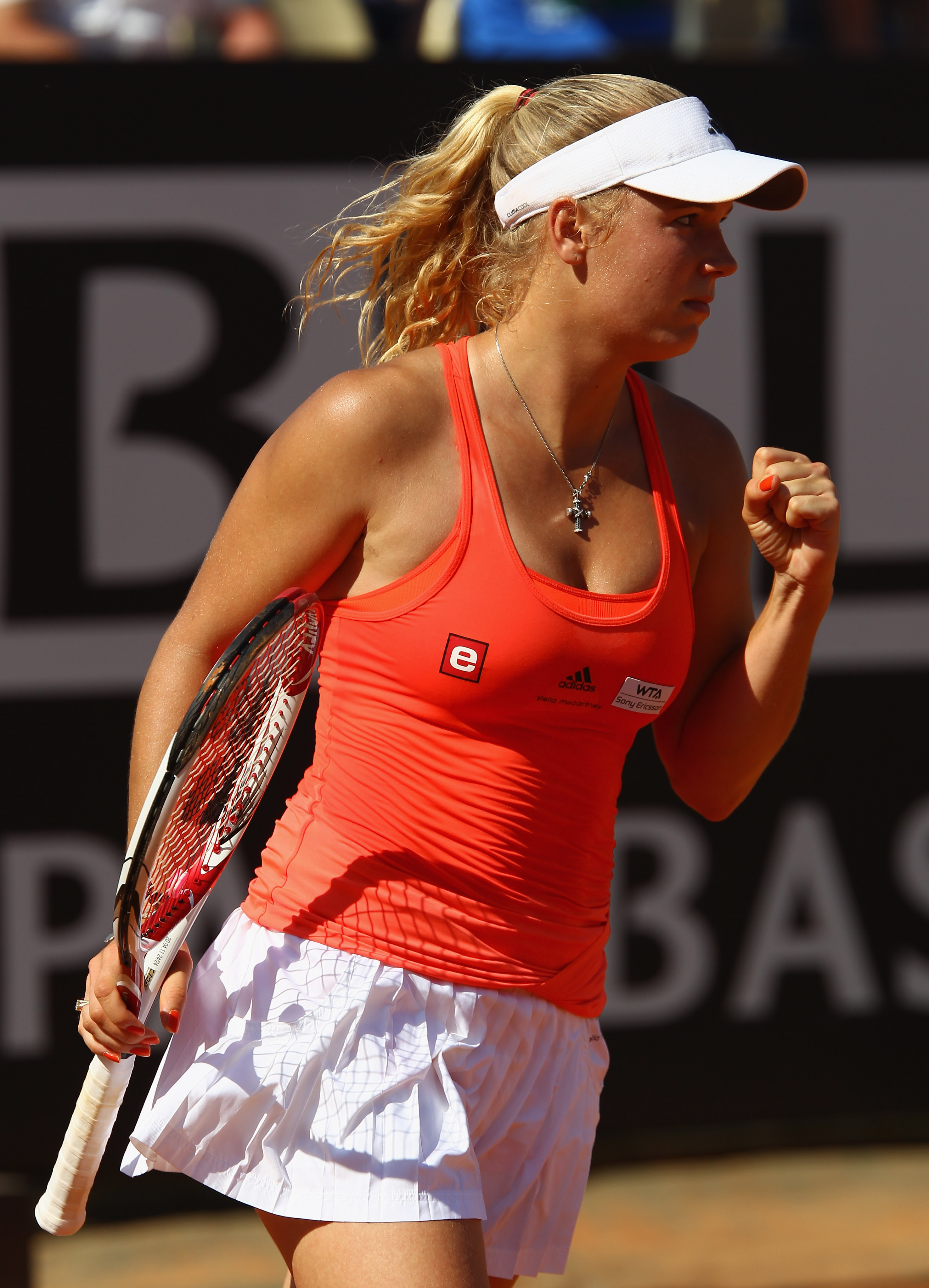ROME, ITALY - MAY 13:  Caroline Wozniacki of Denmark celebrates a point during her quarter final match against Jelena Jankovic of Serbia during day six of the Internazoinali BNL D'Italia at the Foro Italico Tennis Centre  on May 13, 2011 in Rome, Italy.