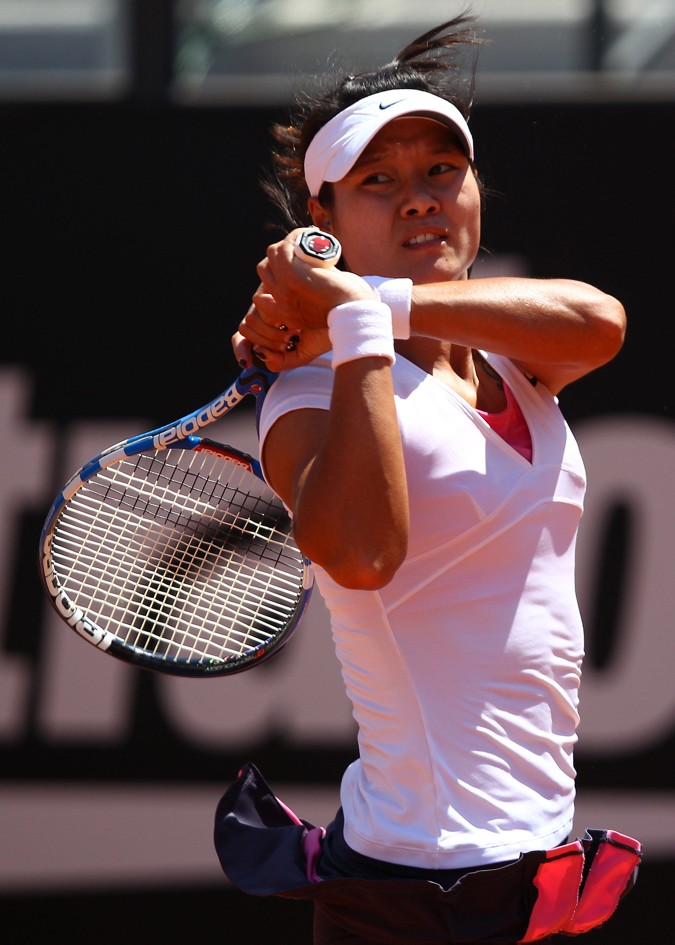 ROME, ITALY - MAY 14:  Li Na of China in action during her semi final match against Sam Stosur of Australia during day seven of the Internazoinali BNL D'Italia at the Foro Italico Tennis Centre  on May 14, 2011 in Rome, Italy.  (Photo by Clive Brunskill/G