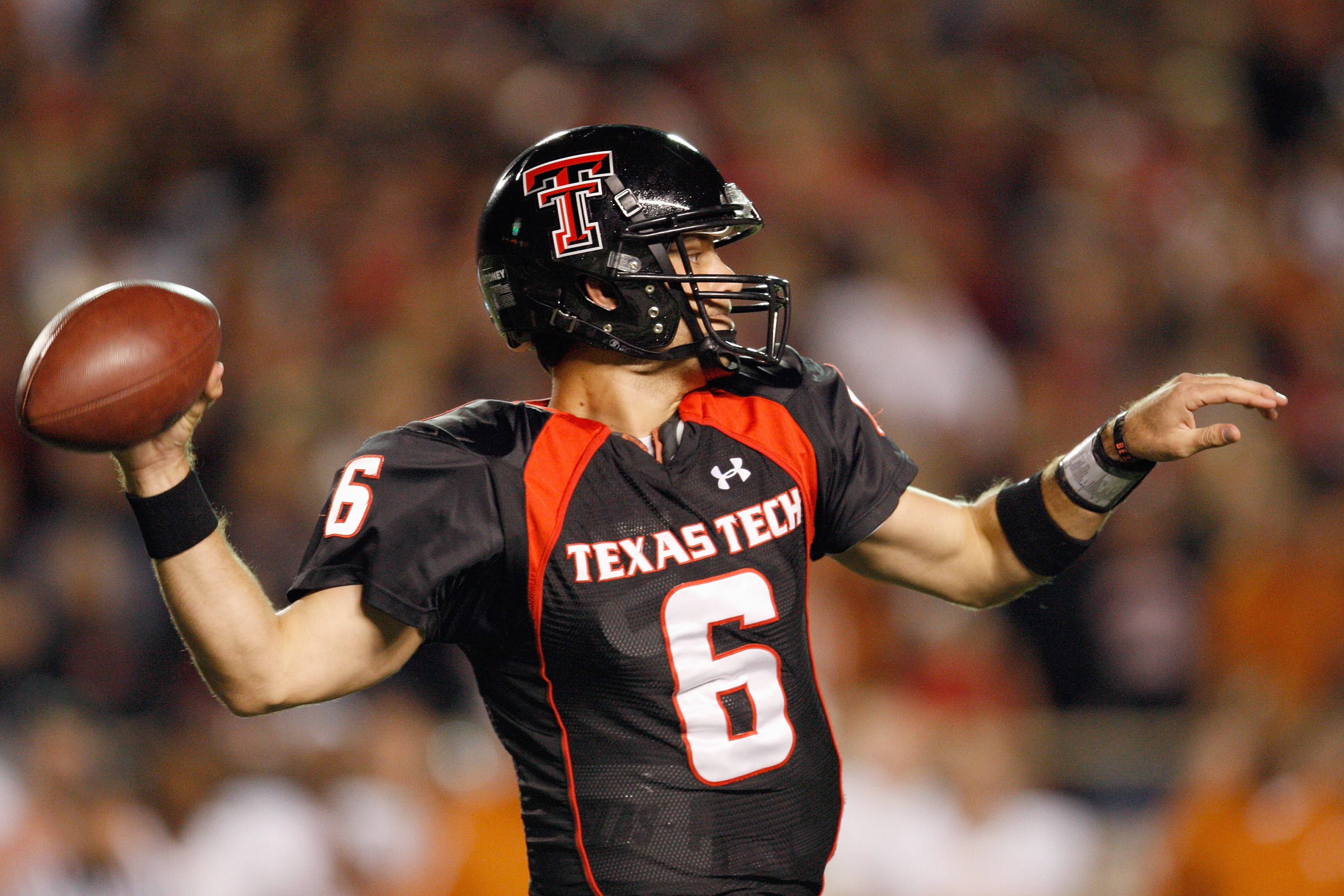LUBBOCK, TEXAS - NOVEMBER 1:  Quarterback Graham Harrell #6 of the Texas Tech Red Raiders looks to pass the ball down the field during the game against the Texas Longhorns on November 1, 2008 at Jones Stadium in Lubbock, Texas. (Photo by: Jamie Squire/Get