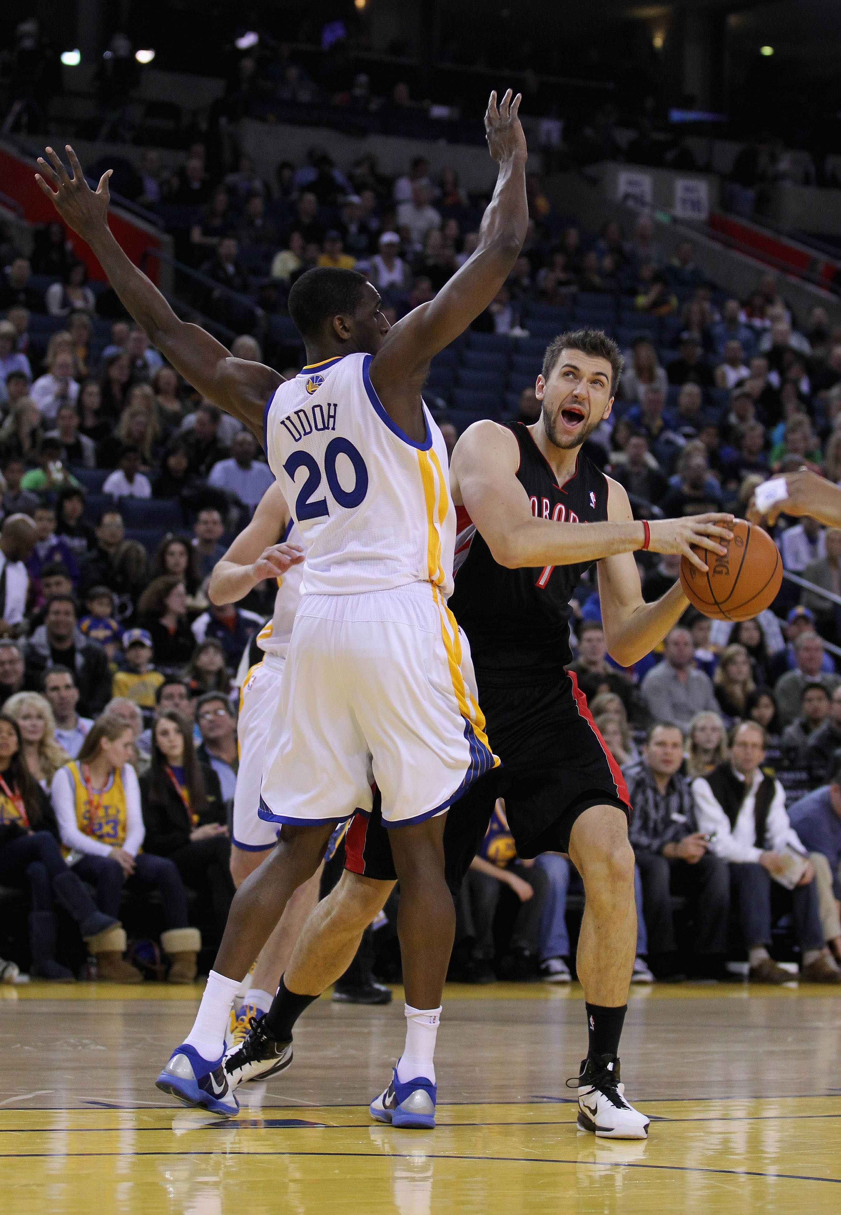 OAKLAND, CA - MARCH 25: Andrea Bargnani #7 of the Toronto Raptors is guarded by Ekpe Udoh #20 of the Golden State Warriors at Oracle Arena on March 25, 2011 in Oakland, California. NOTE TO USER: User expressly acknowledges and agrees that, by downloading