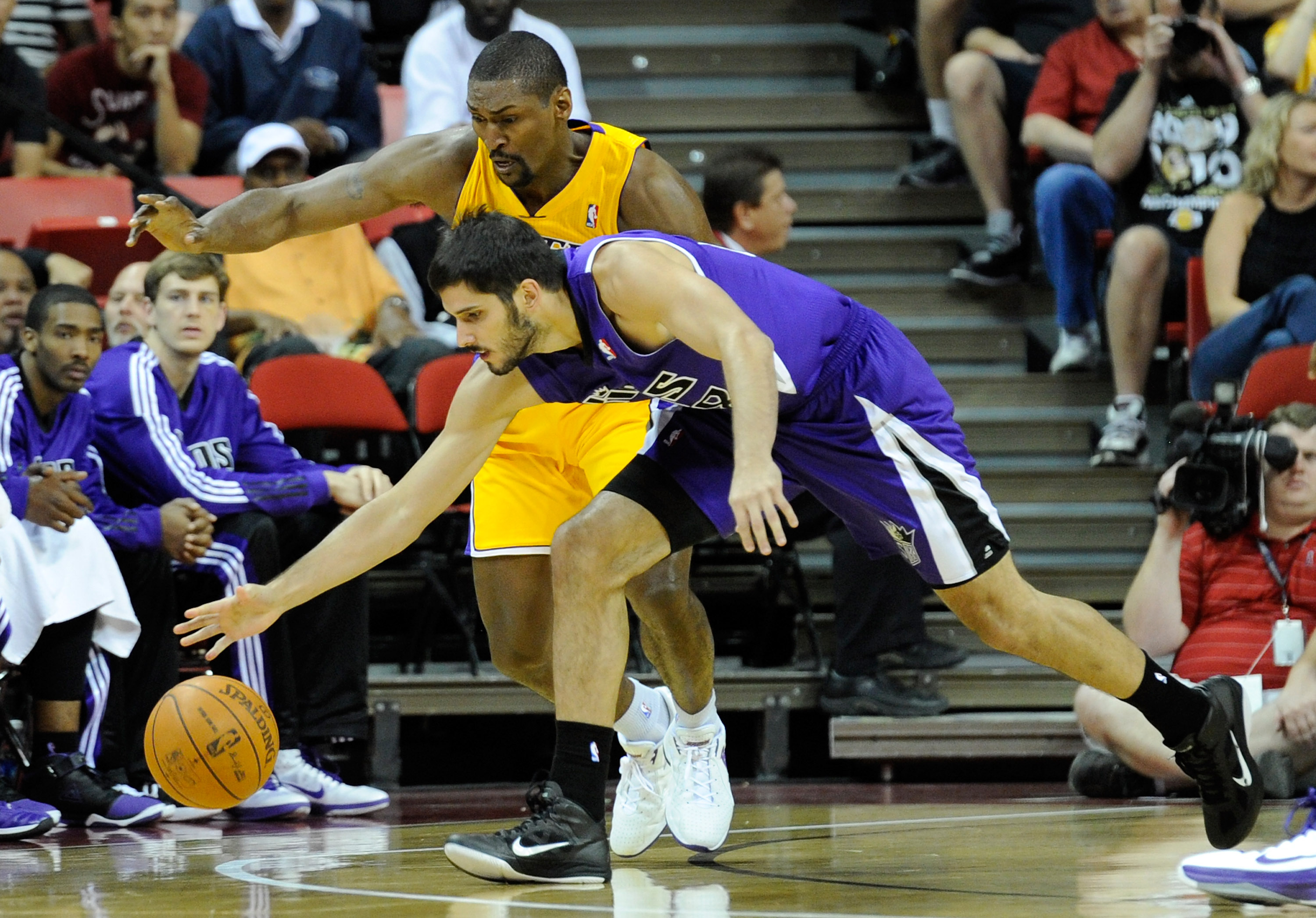 LAS VEGAS - OCTOBER 13:  Ron Artest #15 of the Los Angeles Lakers tries to steal the ball from Omri Casspi #18 of the Sacramento Kings during their preseason game at the Thomas & Mack Center October 13, 2010 in Las Vegas, Nevada. The Lakers won 98-95. NOT