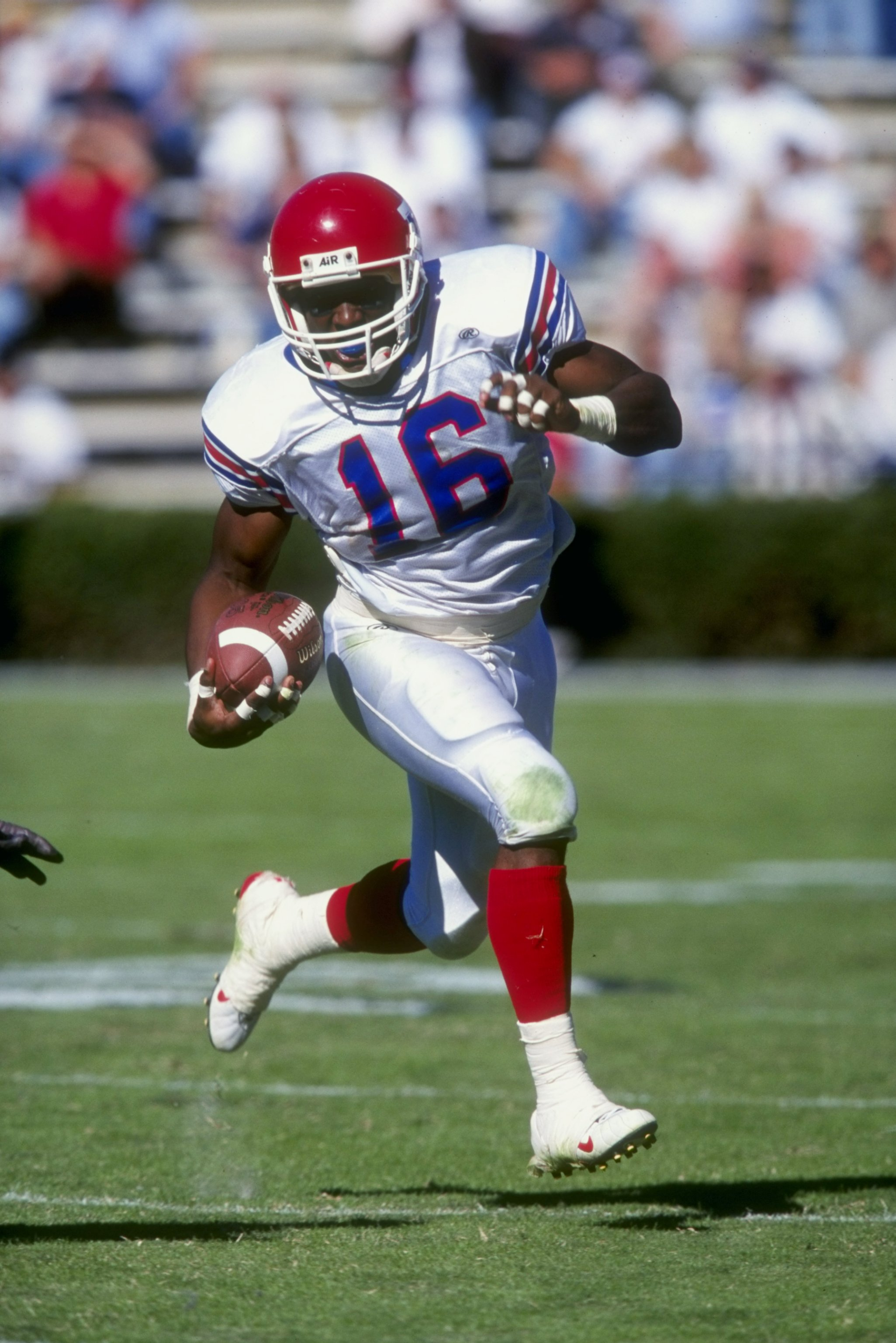 24 Oct 1998: Troy Edwards #16 of the Louisiana Tech Bulldogs grips the ball as he runs during the game against the Auburn Tigers at Jordan- Hare Stadium in Auburn, Alabama. Auburn defeated Lousiana Tech 32-17. Mandatory Credit: Tom Hauck  /Allsport