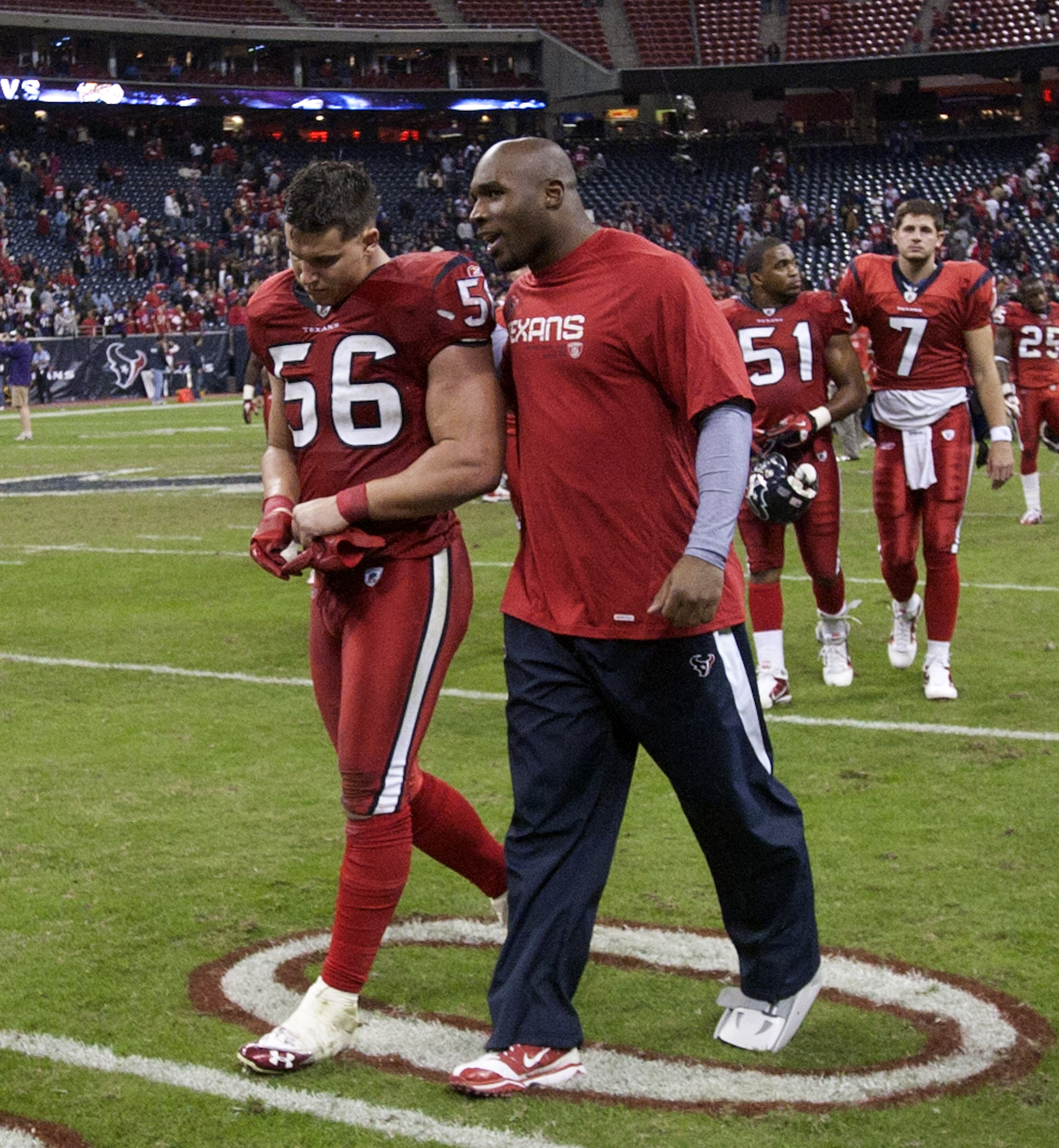 HOUSTON, TX - DECEMBER 13:  Linebacker Brian Cushing #56 and injured linebacker DeMeco Ryan walk off the field after Houston lost in overtime to Baltimore Ravens at Reliant Stadium on December 13, 2010 in Houston, Texas.  (Photo by Bob Levey/Getty Images)