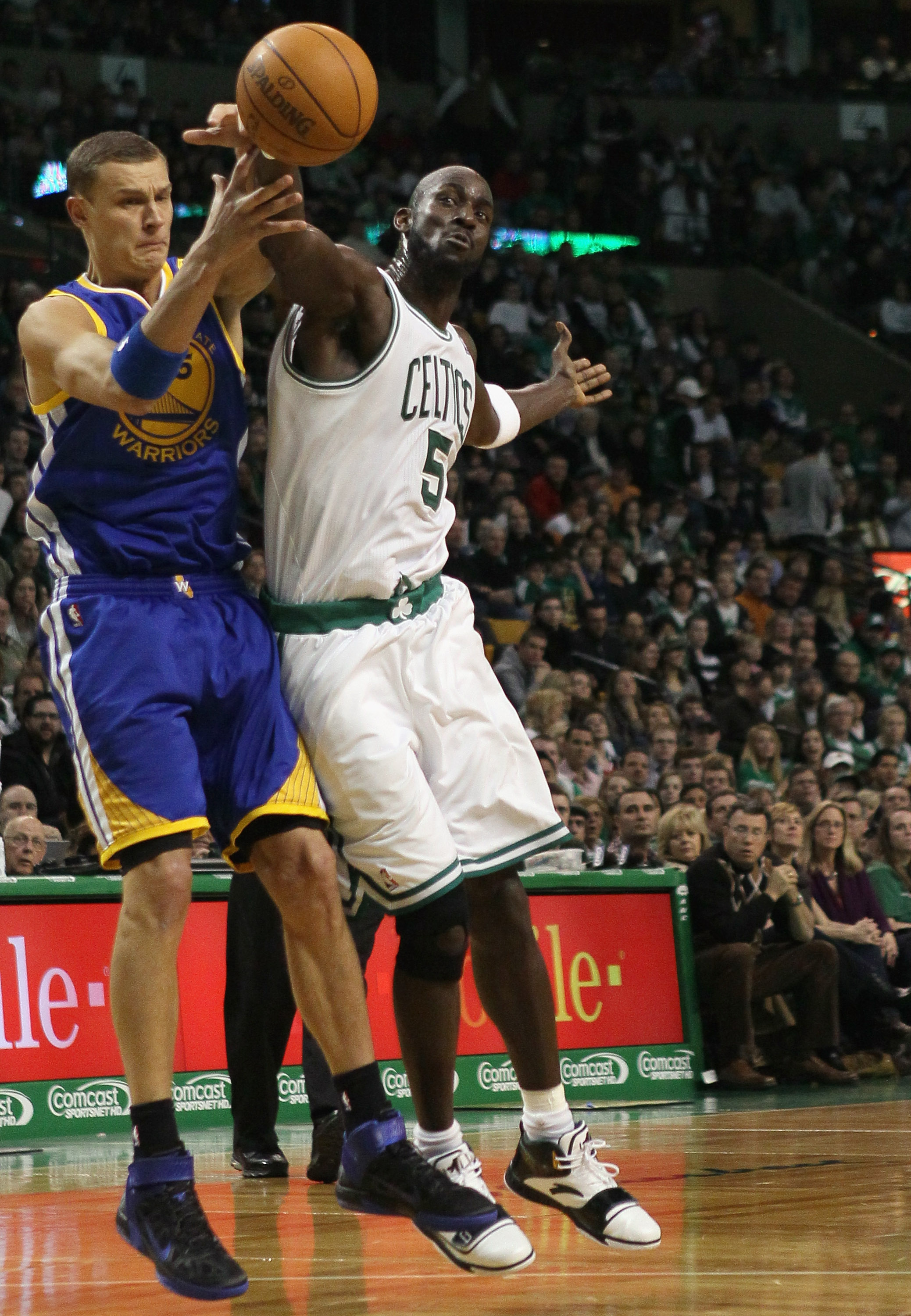 BOSTON, MA - MARCH 04:  Kevin Garnett #5 of the Boston Celtics tries to keep the ball from Andris Biedrins #15 of the Golden State Warriors on March 4, 2011 at the TD Garden in Boston, Massachusetts.  NOTE TO USER: User expressly acknowledges and agrees t