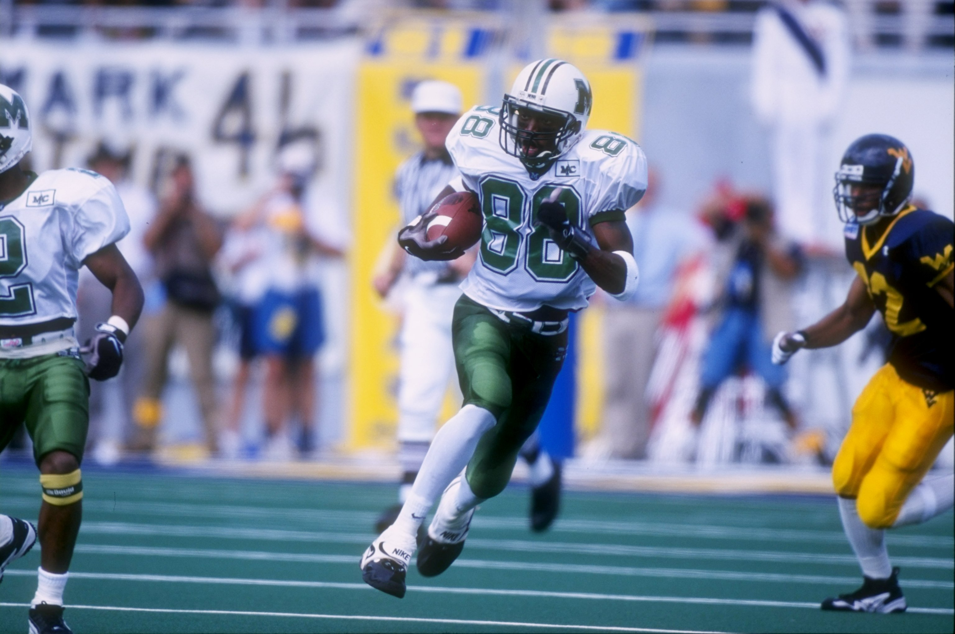 30 Aug 1997:  Wide receiver Randy Moss #88 of the Marshall Thundering Herd carries to football during the Thundering Herd 42-31 loss to the West Virginia Moutaineers at Mountaineer Field in Morgantown, West Virginia.  Mandatory Credit: Rick Stewart  /Alls