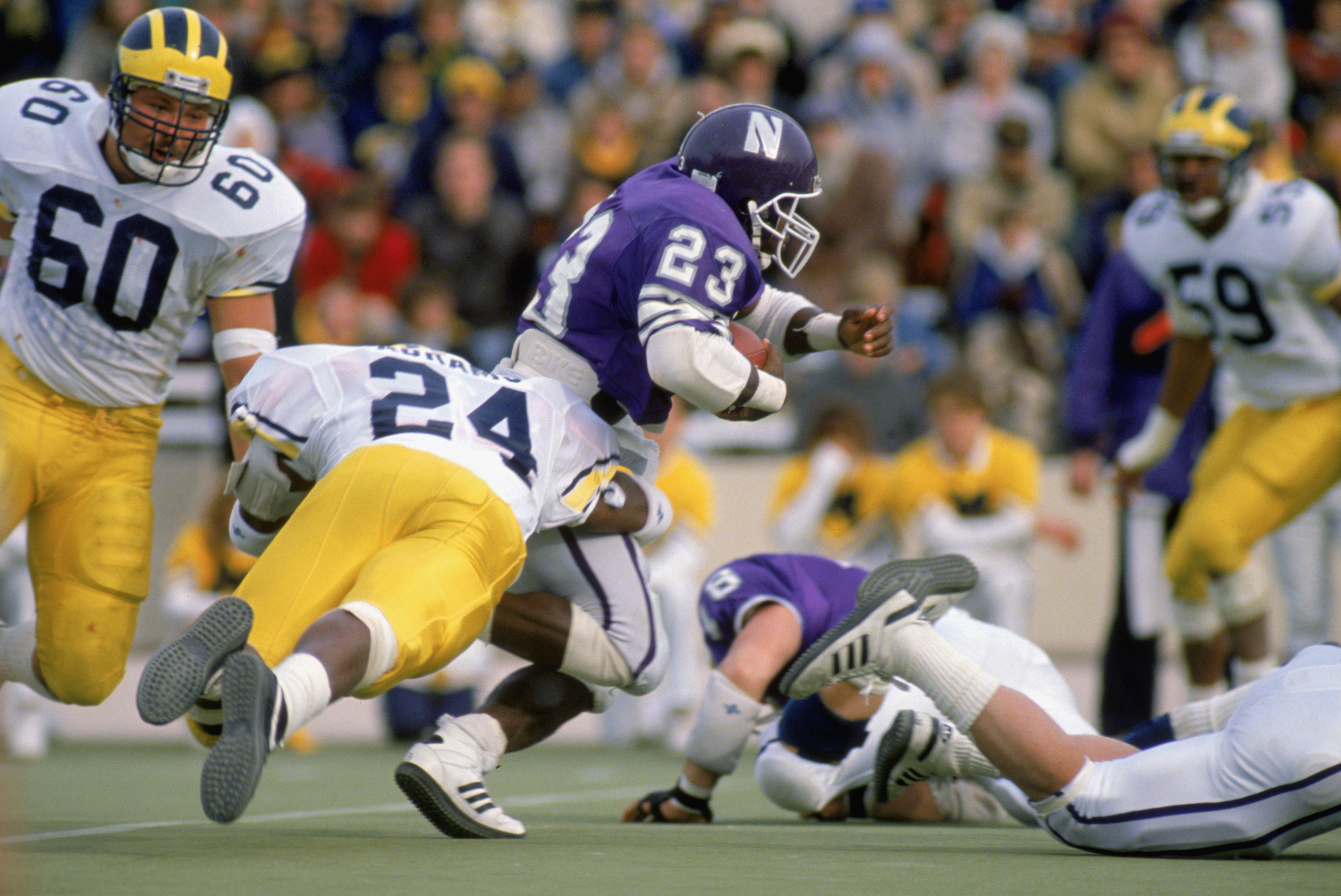 1988:  Byron Sanders #23 of Northwestern University Wildcats carries the ball during a game against the University of Michigan Wolverines in the 1988 season. (Photo by: Jonathan Daniel/Getty Images)