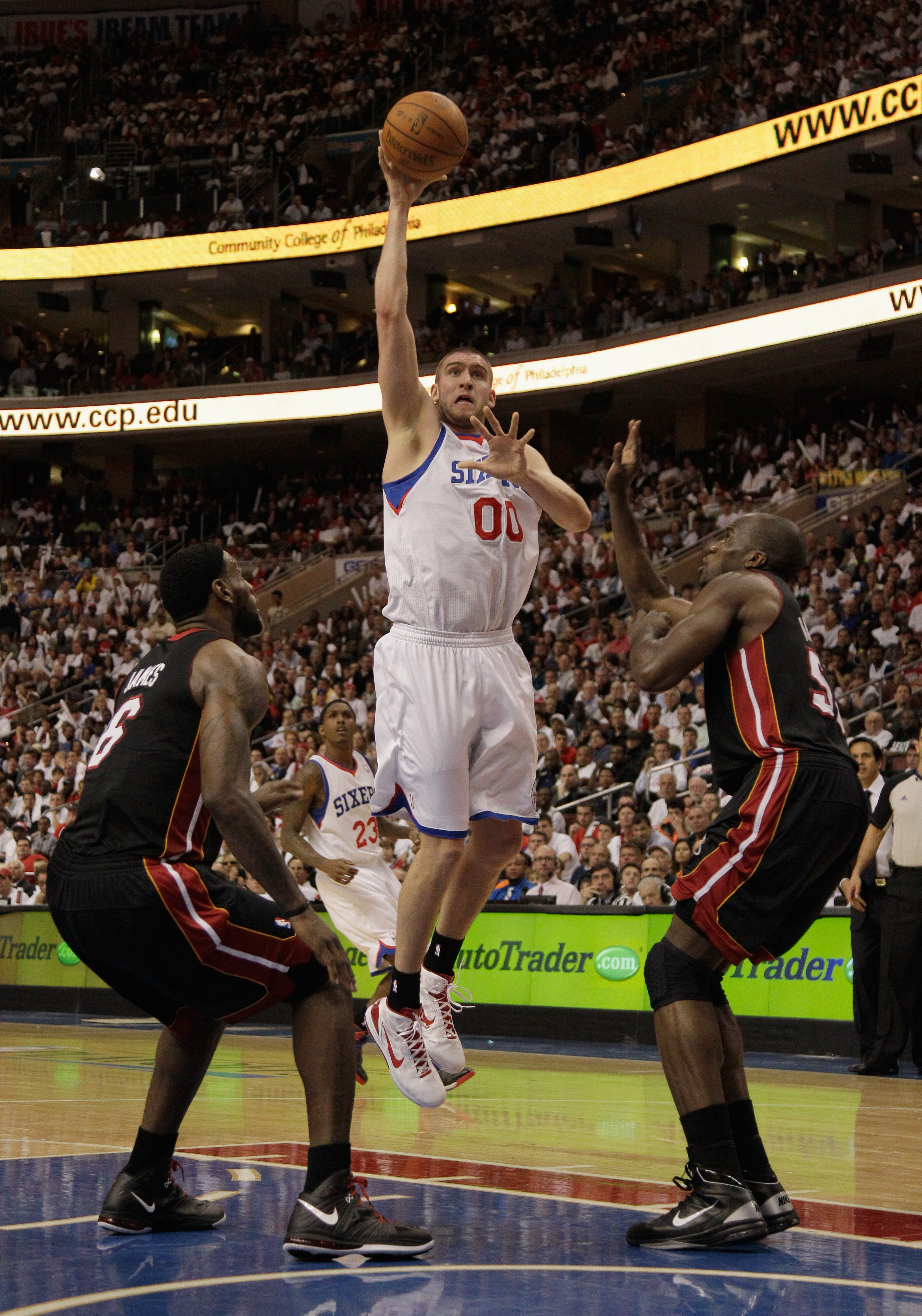 PHILADELPHIA, PA - APRIL 21: Spencer Hawes #00 of the Philadelphia 76ers puts up a shot against the Miami Heat in Game Three of the Eastern Conference Quarterfinals during the 2011 NBA Playoffs at Wells Fargo Center on April 21, 2011 in Philadelphia, Penn