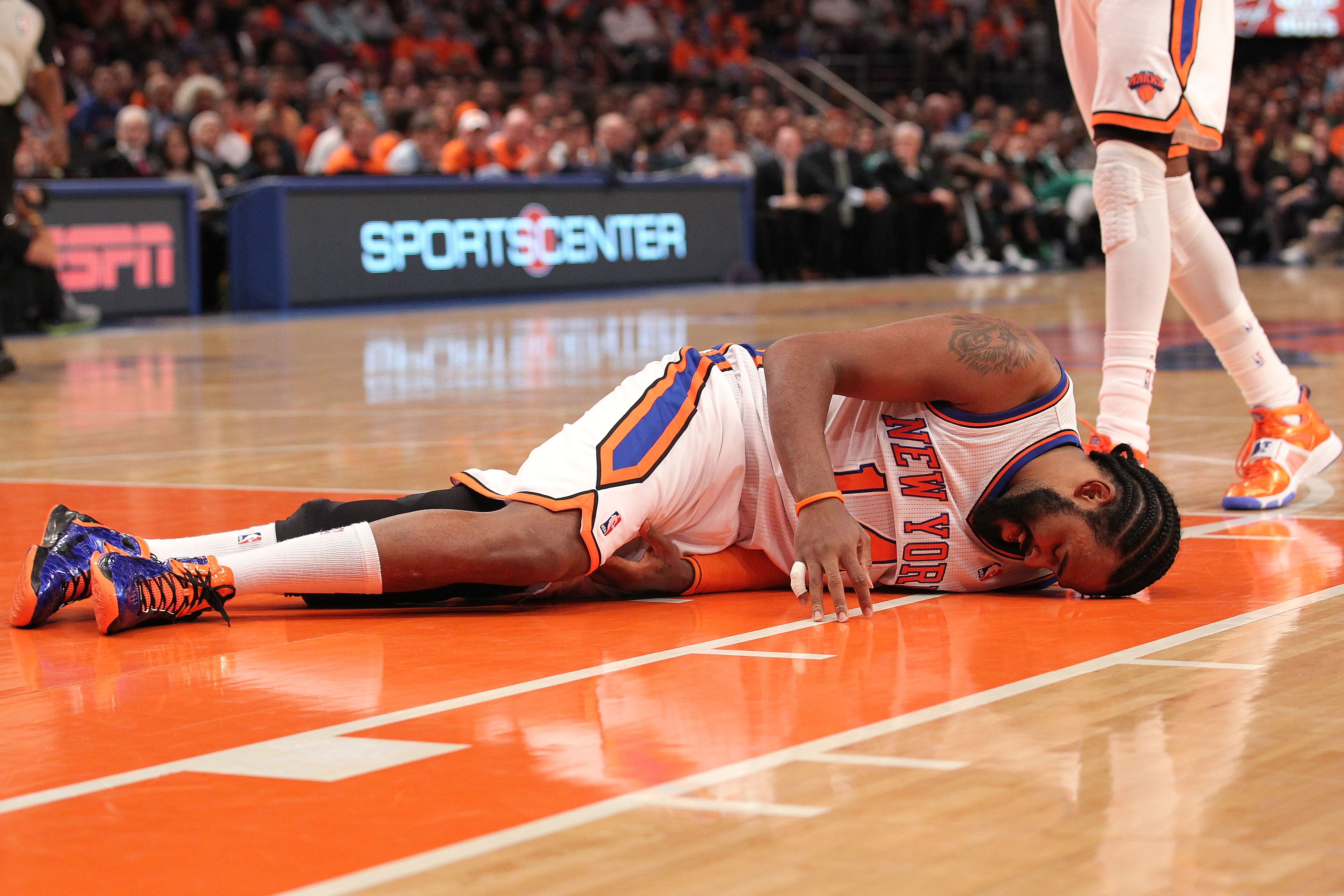 NEW YORK, NY - APRIL 24:  Ronny Turiaf #14 of the New York Knicks lies on the court in pain against the Boston Celtics in Game Four of the Eastern Conference Quarterfinals during the 2011 NBA Playoffs on April 24, 2011 at Madison Square Garden in New York