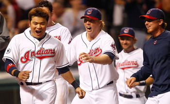 CLEVELAND - MAY 13:  Shin-Soo Choo #17 of the Cleveland Indians and members of his team celebrate following the walk-off two run home run by Travis Hafner #48 in the 9th inning against the Seattle Mariners during the game on May 13, 2011 at Progressive Fi