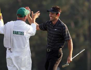 AUGUSTA, GA - APRIL 10:  Charl Schwartzel of South Africa celebrates his birdie on the 18th green with his caddie Greg Hearmon and winning the Masters during the final round of the 2011 Masters Tournament at Augusta National Golf Club on April 10, 2011 in