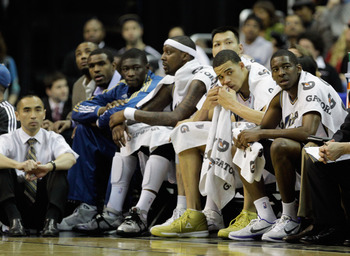 WASHINGTON, DC - MARCH 30:  Members of the Washington Wizards look on from the bench during thier game against the Miami Heat at the Verizon Center on March 30, 2011 in Washington, DC. NOTE TO USER: User expressly acknowledges and agrees that, by download