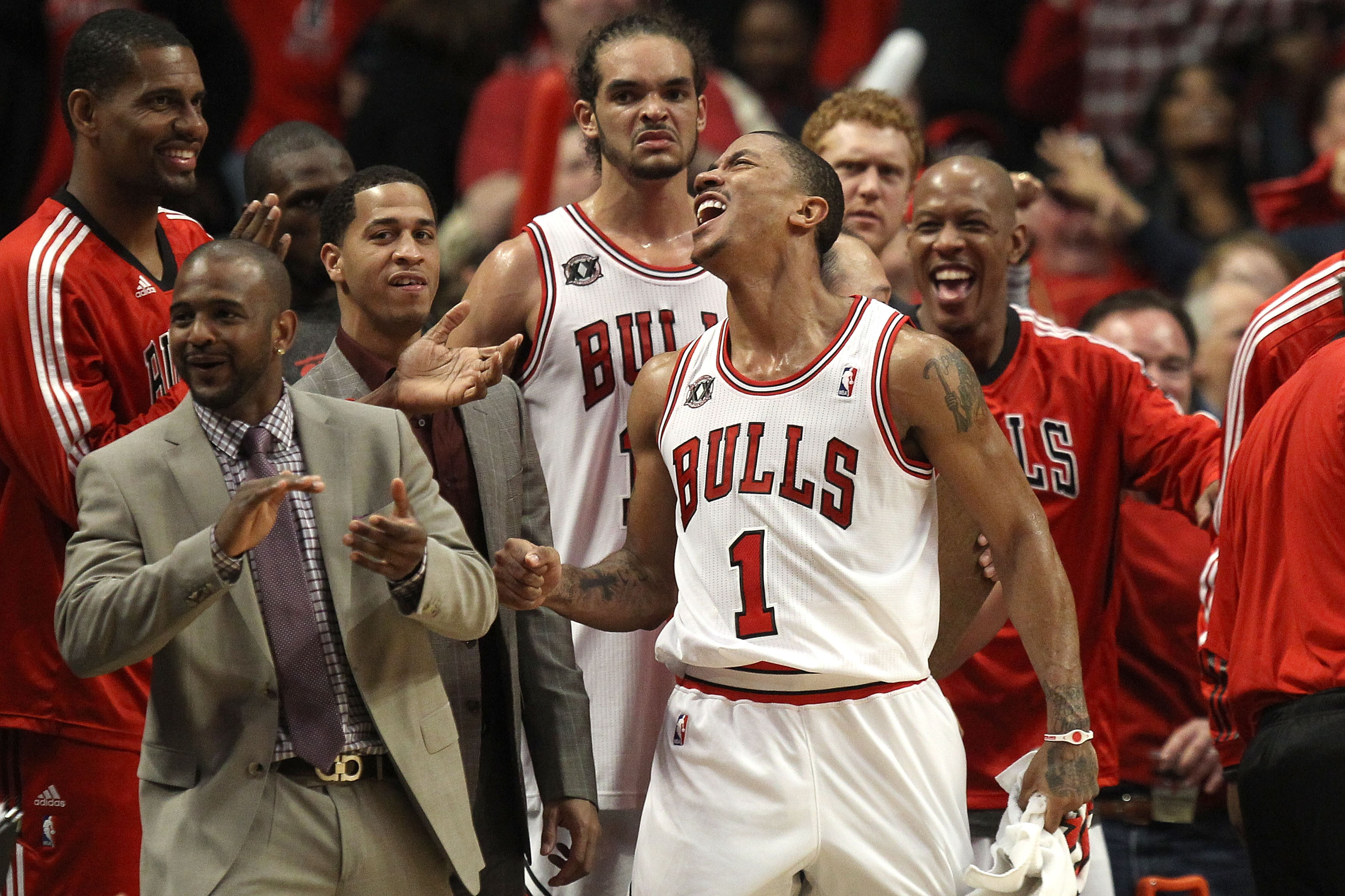 CHICAGO, IL - MAY 15:  (L-R) Kurt Thomas #40, John Lucas III, Joakim Noah #13, Derrick Rose #1 and Keith Bogans #6 of the Chicago Bulls celebrate late in the fourth quarter against the Miami Heat in Game One of the Eastern Conference Finals during the 201